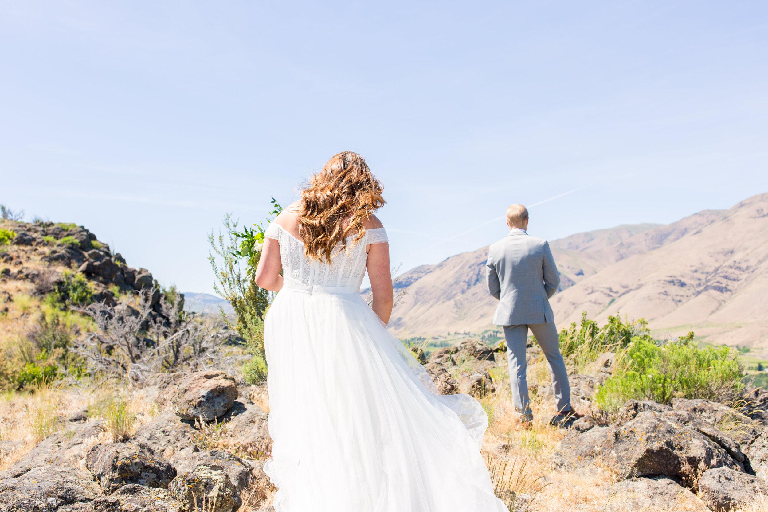 orchard winery spokane wedding bride and groom first look