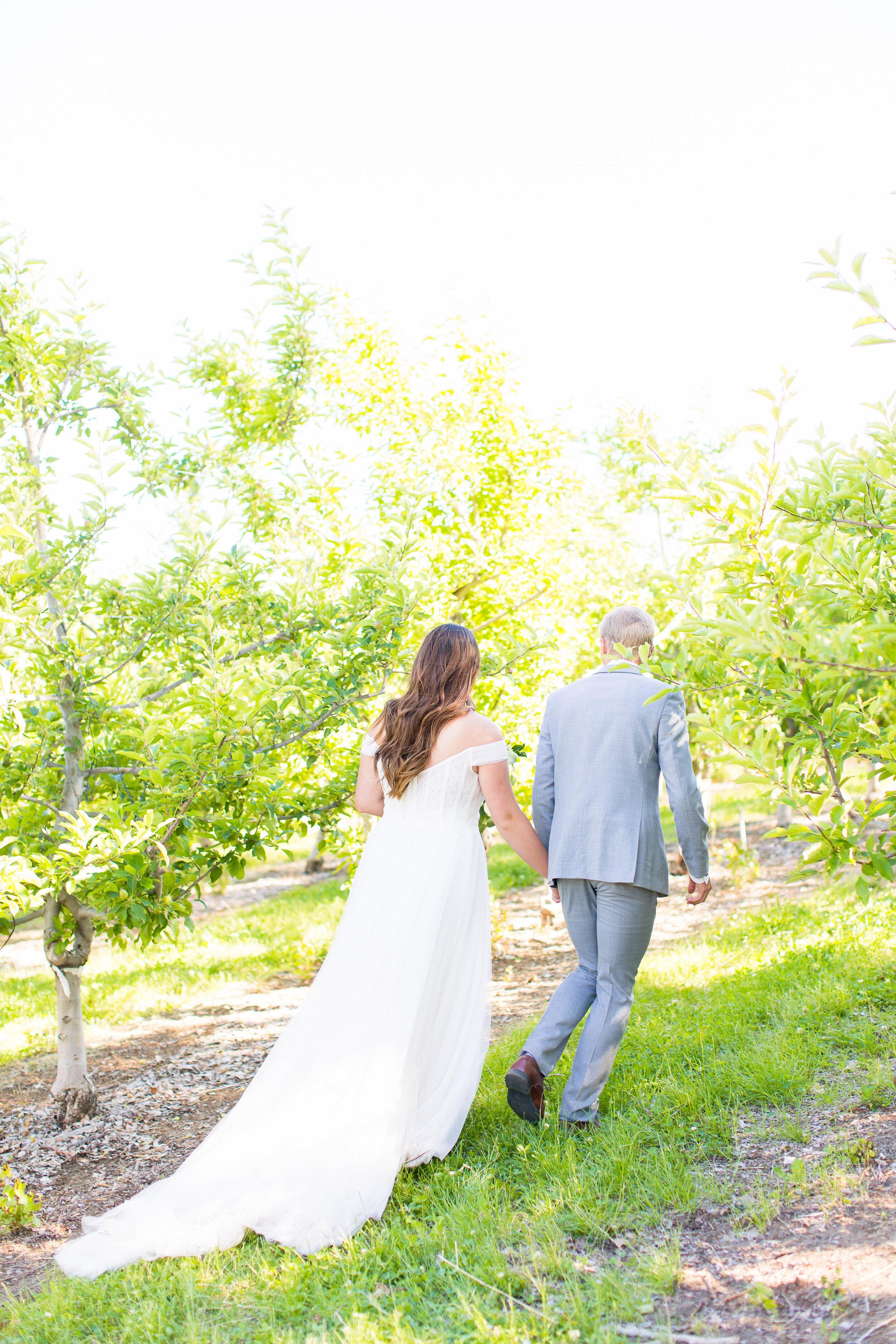bride and groom running away together spokane winery wedding