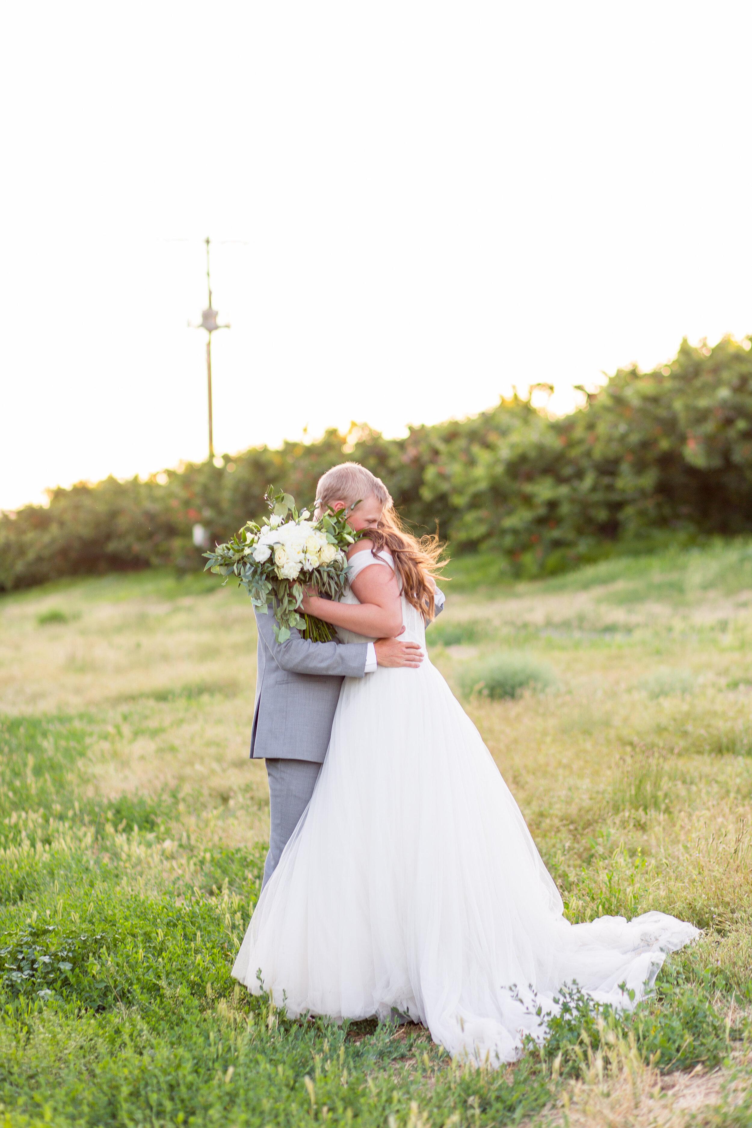 bride and groom dancing together spokane wedding