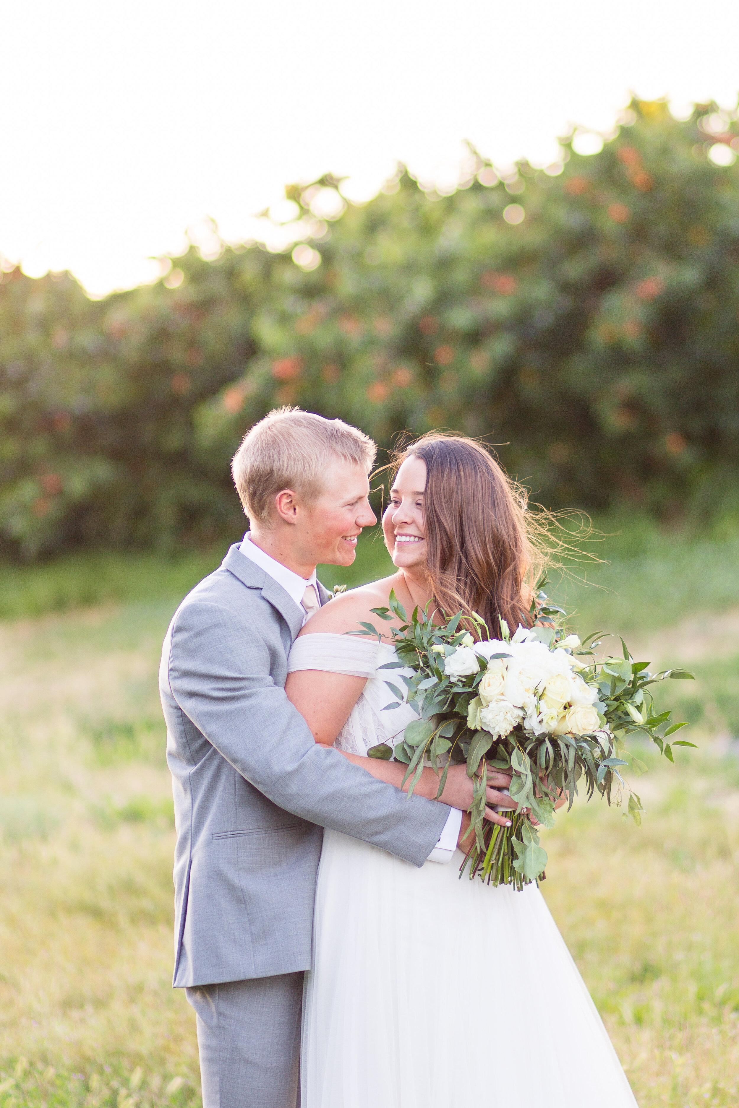 bride and groom embracing spokane wedding