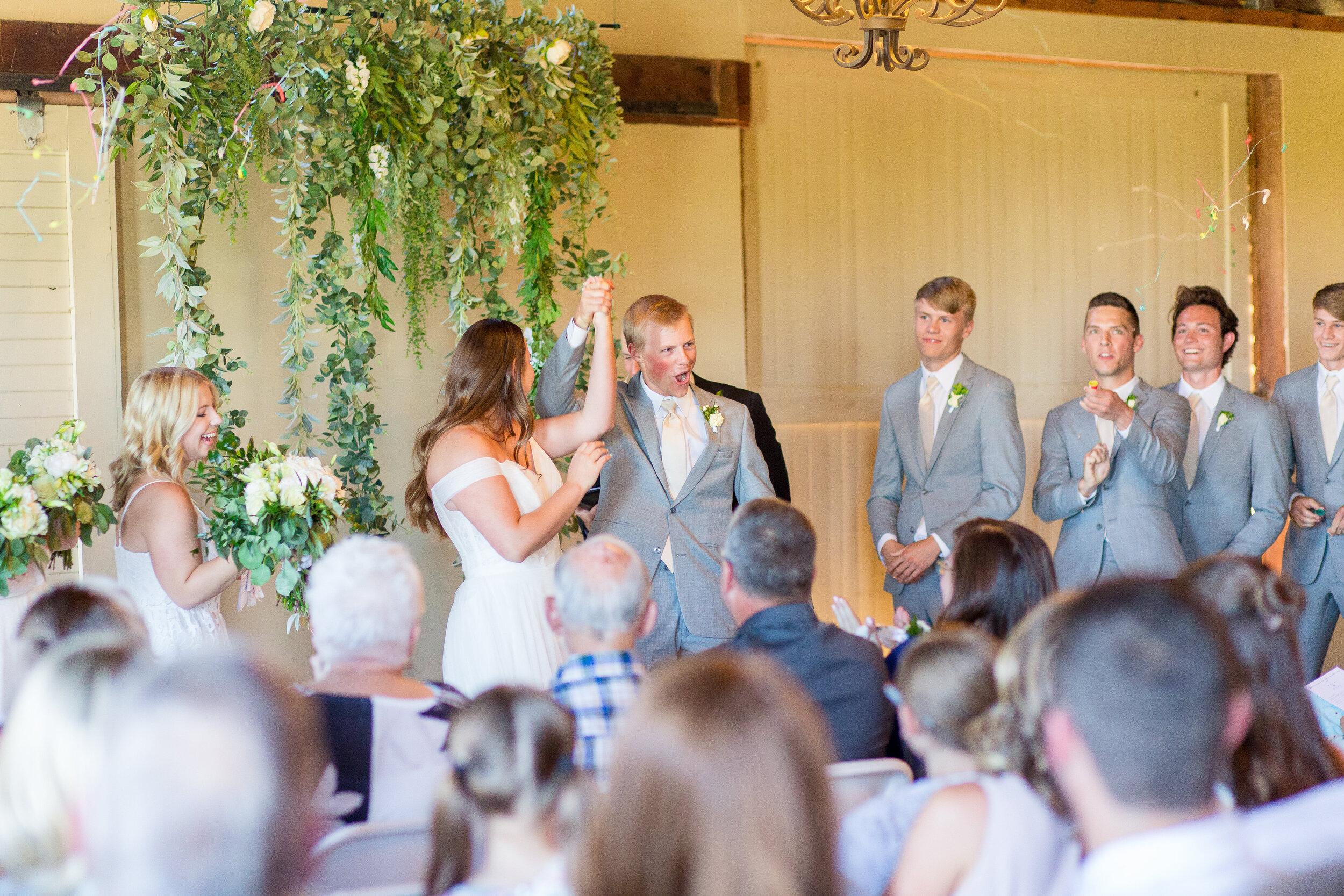 spokane bride and groom first kiss celebration