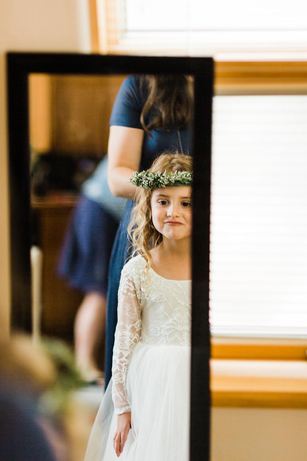flower girl getting ready spokane wedding