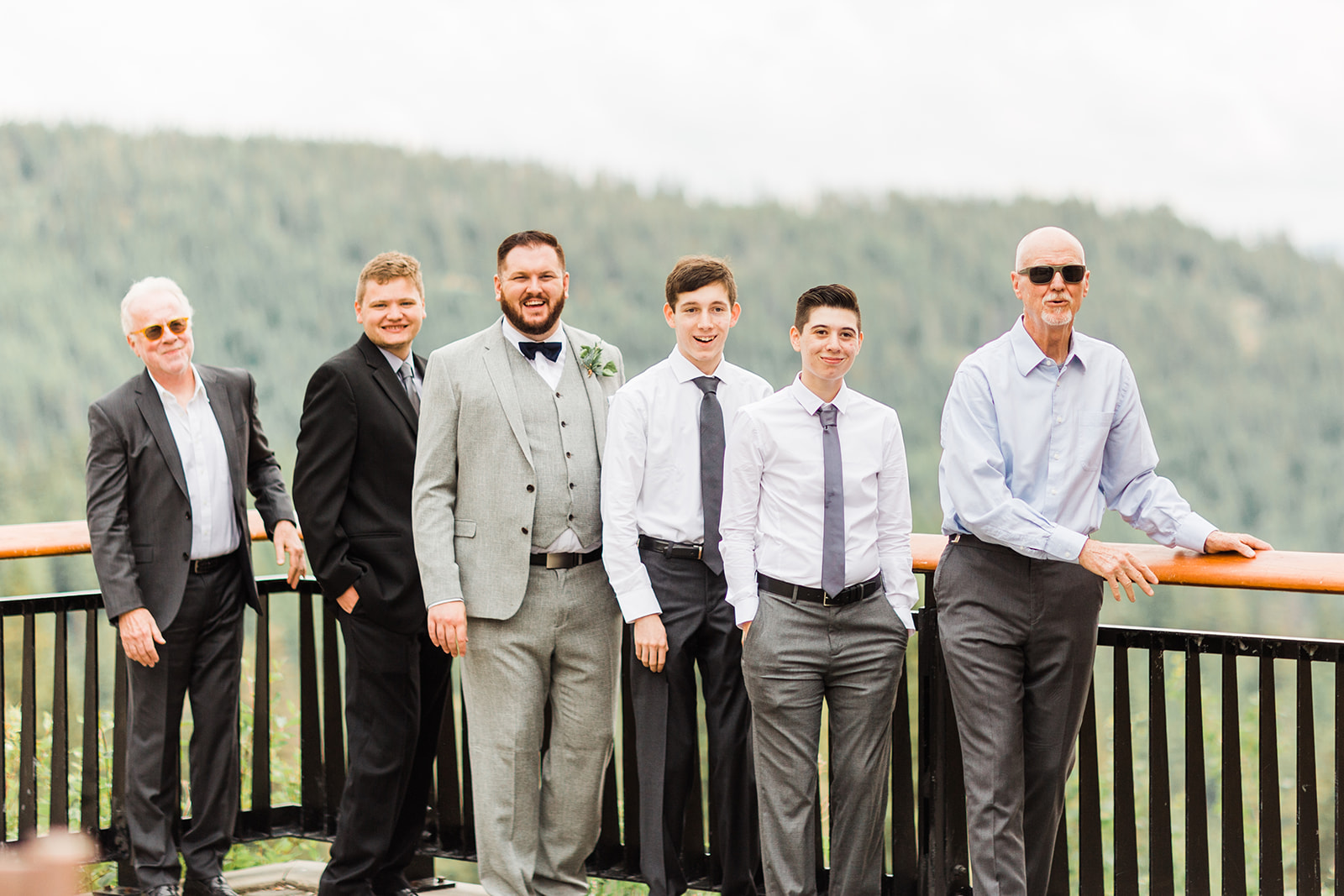 first look spokane bride with men