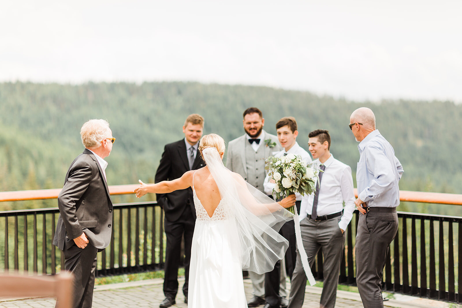 spokane bride first look with dads and brothers