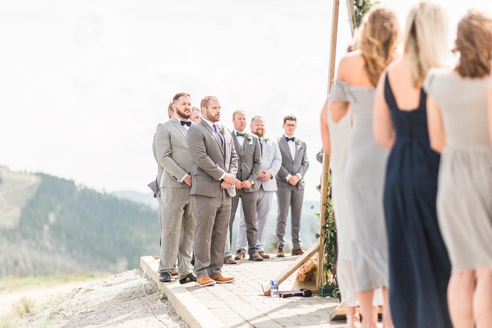 bridesmaids and groomsmen looking on spokane wedding ceremony