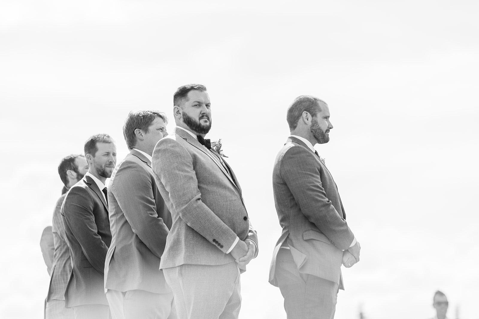 groomsmen looking on spokane wedding ceremony