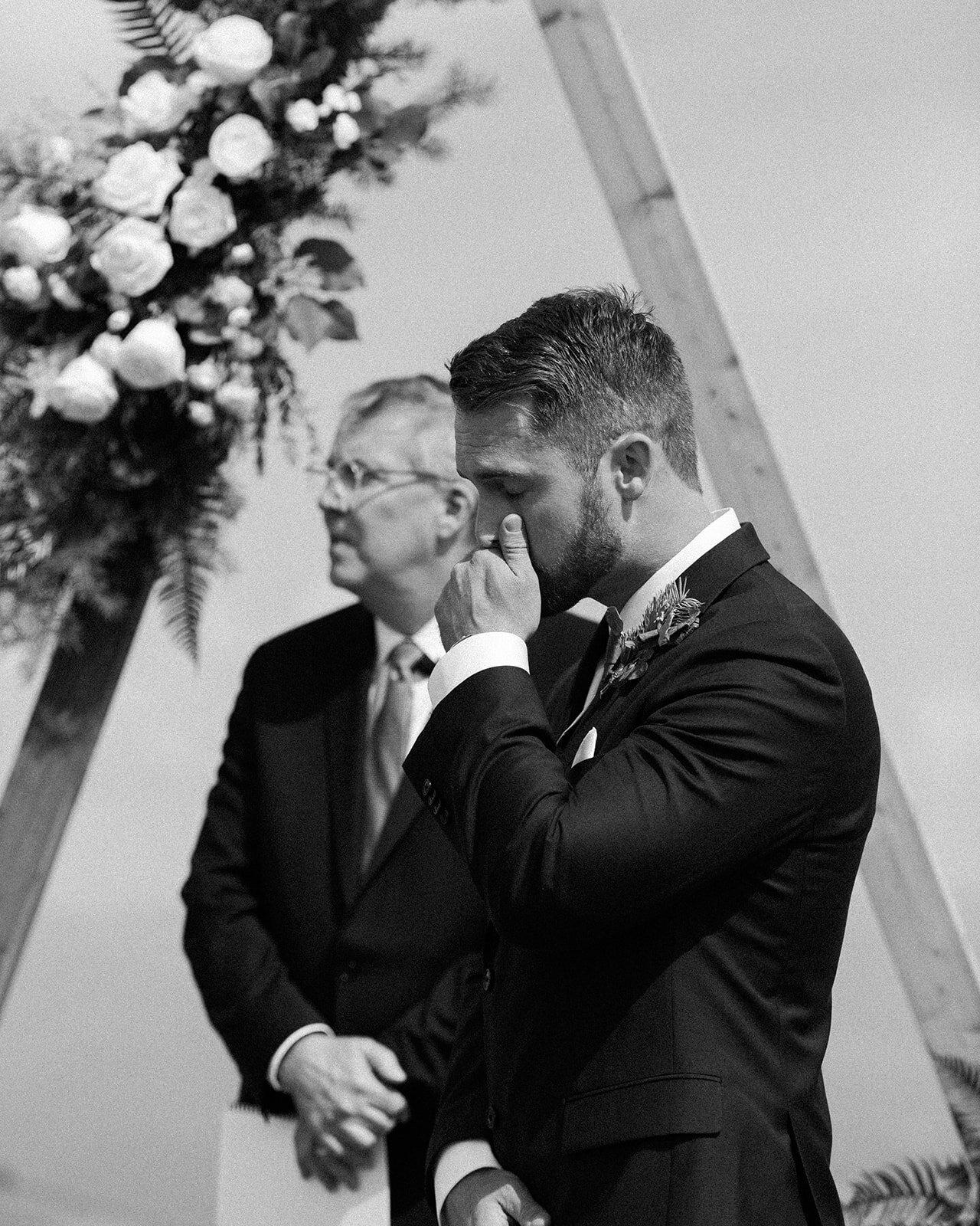 bride and groom first look in ceremony spokane wedding