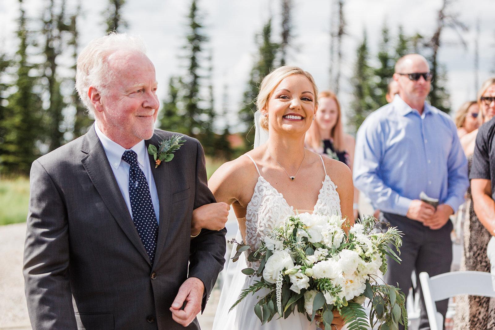 bride and dad walking down aisle spokane wedding