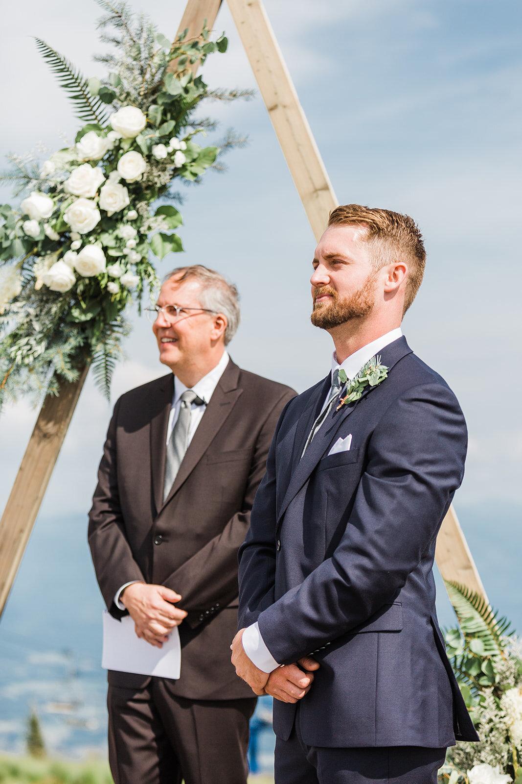 groom first look spokane wedding bride
