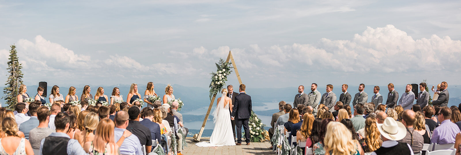 bride and groom with wedding party spokane ceremony