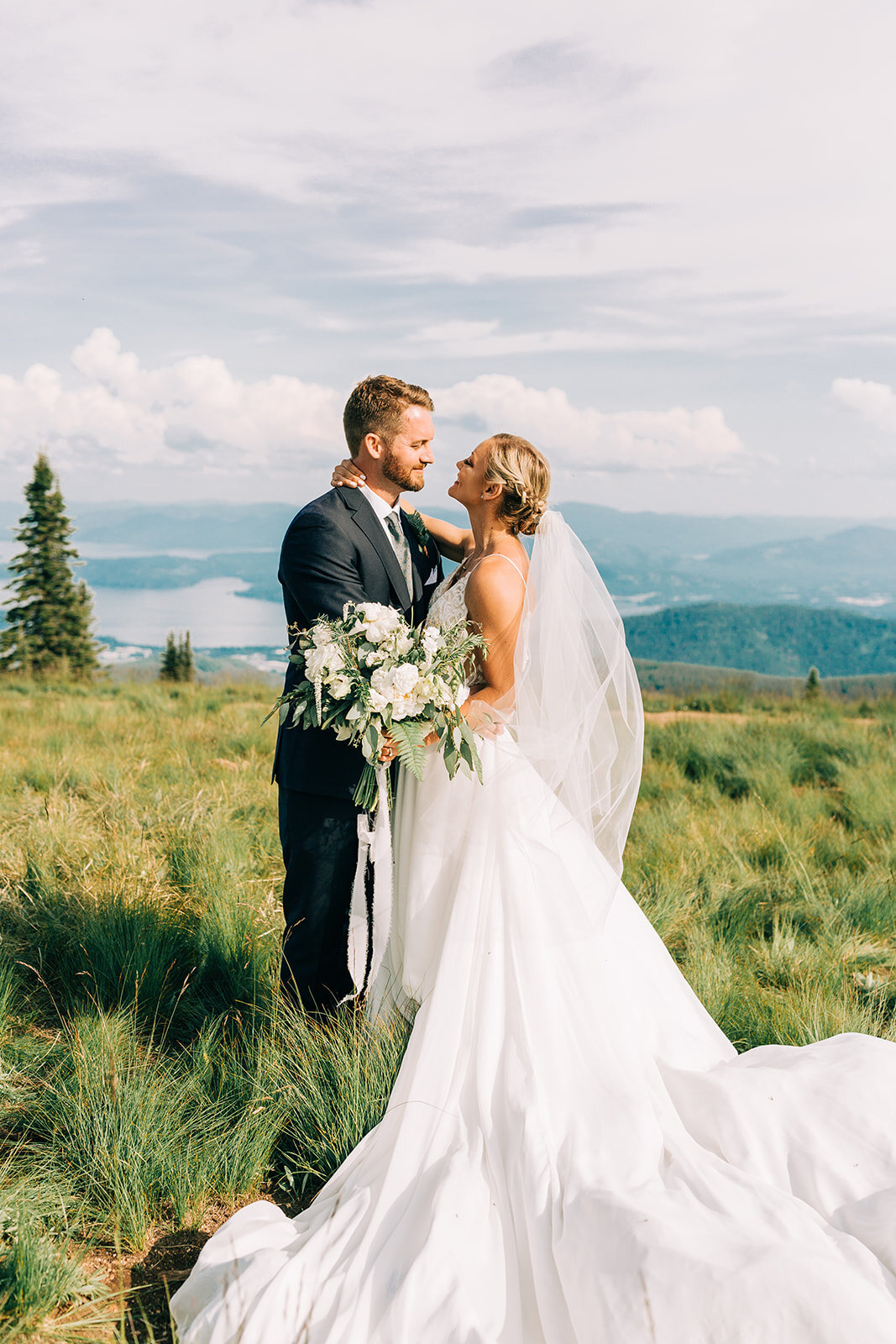 bride and groom lamour long train gown spokane bridal shop