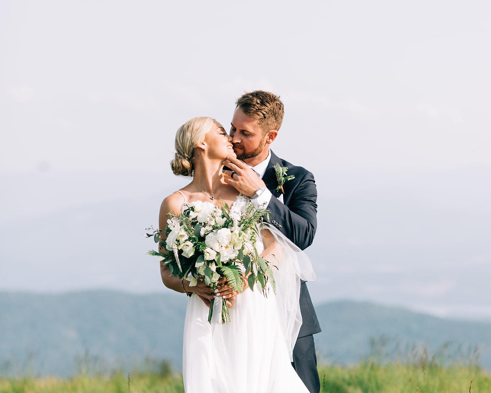 bride and groom kissing wedding portraits spokane