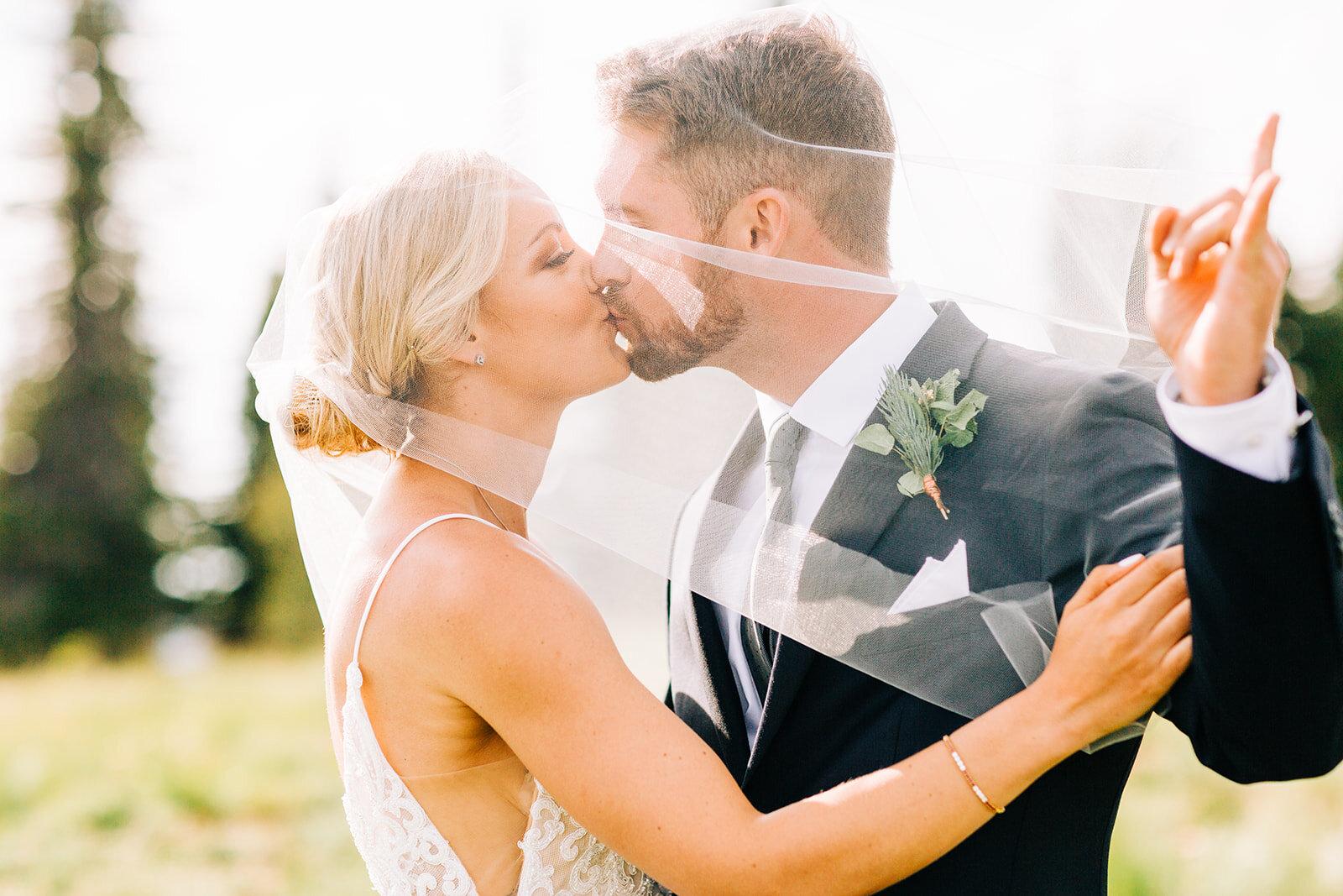 bride and groom under sara gabriel veil spokane