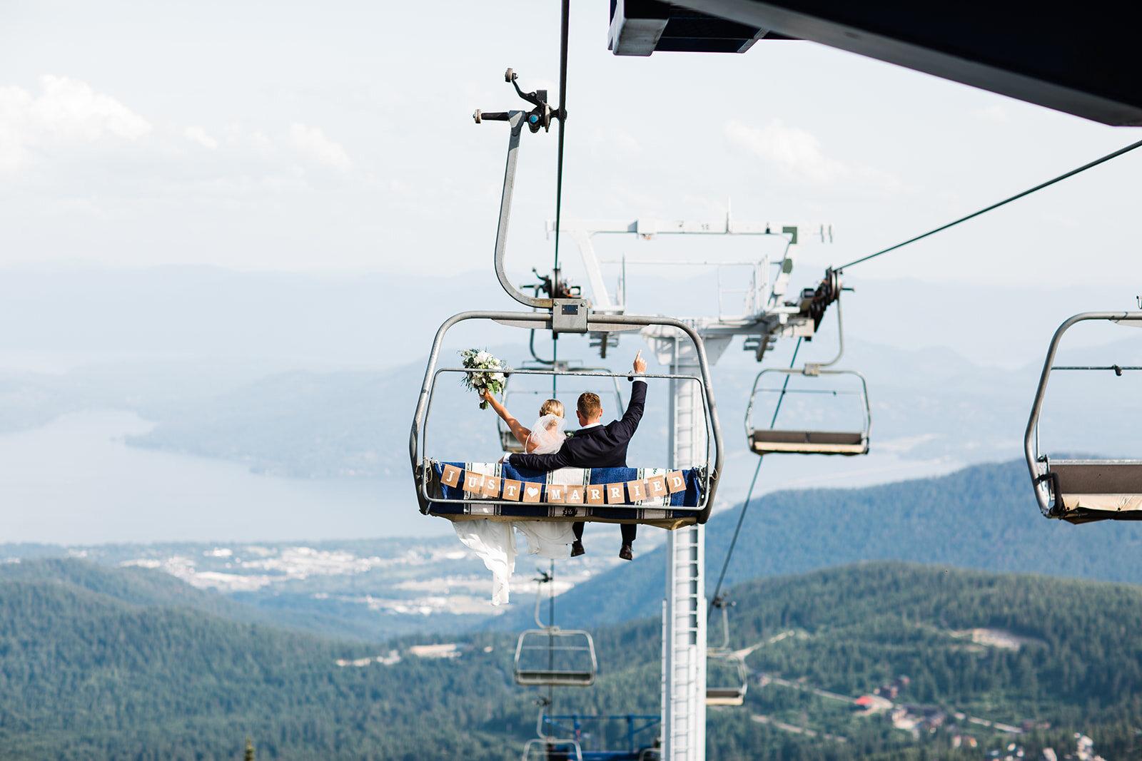 just married chair lift spokane bride and groom