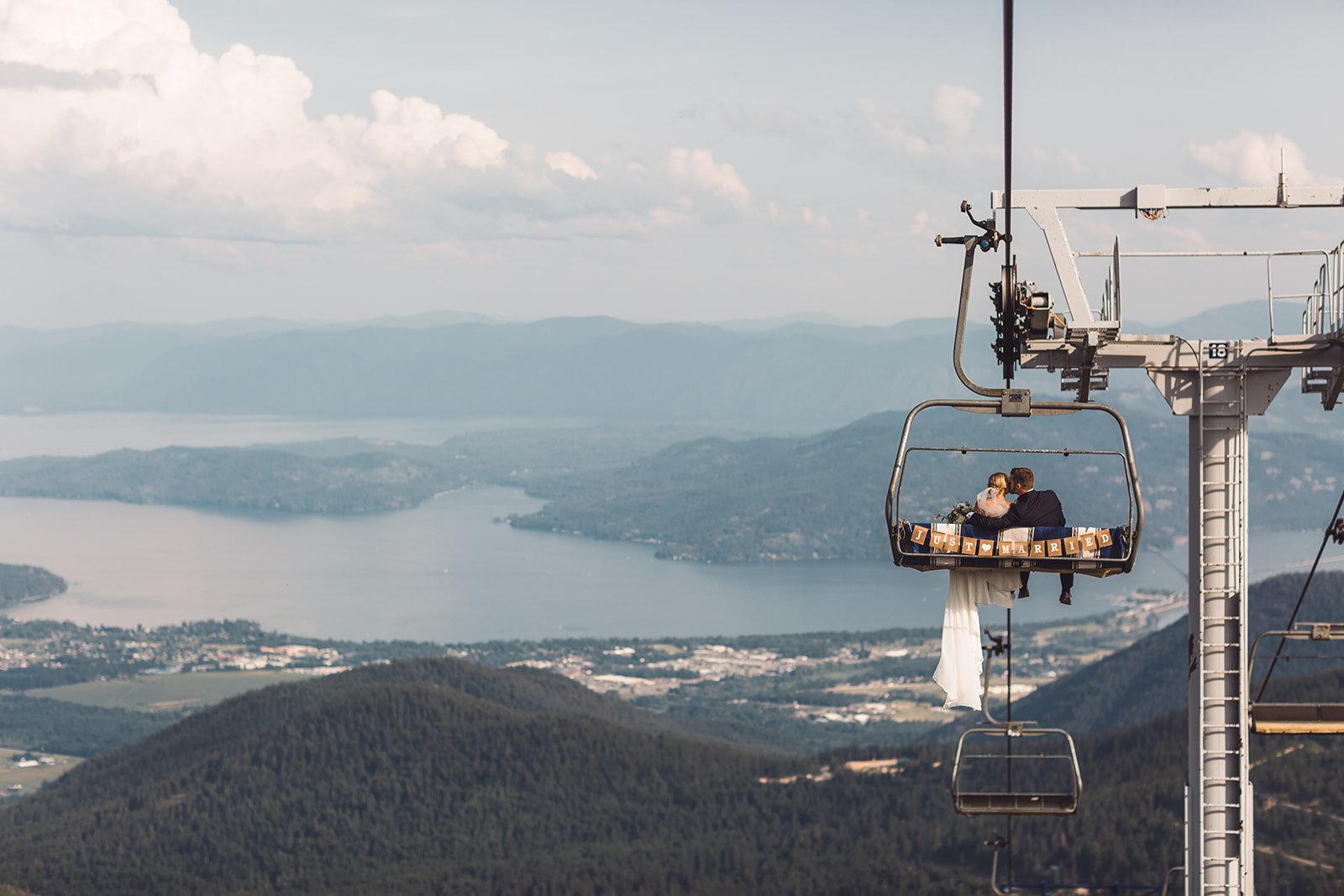 chair lift mountaintop wedding spokane bride and groom