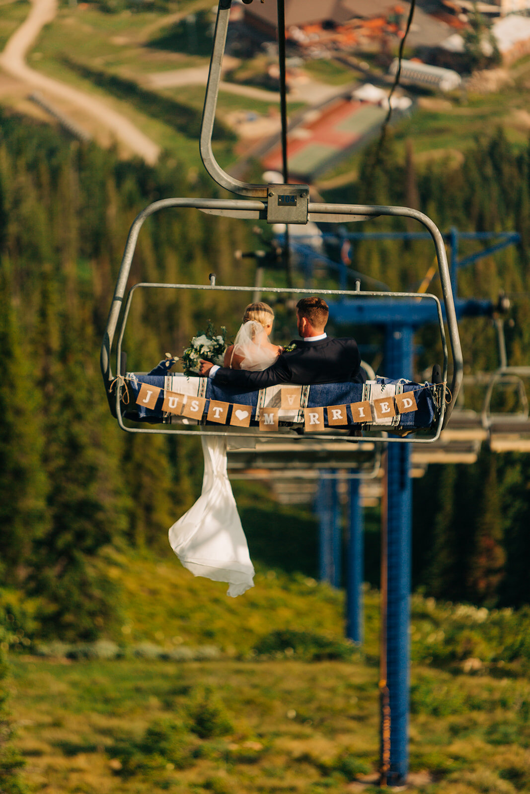 bride and groom chairlift down from wedding ceremony spokane
