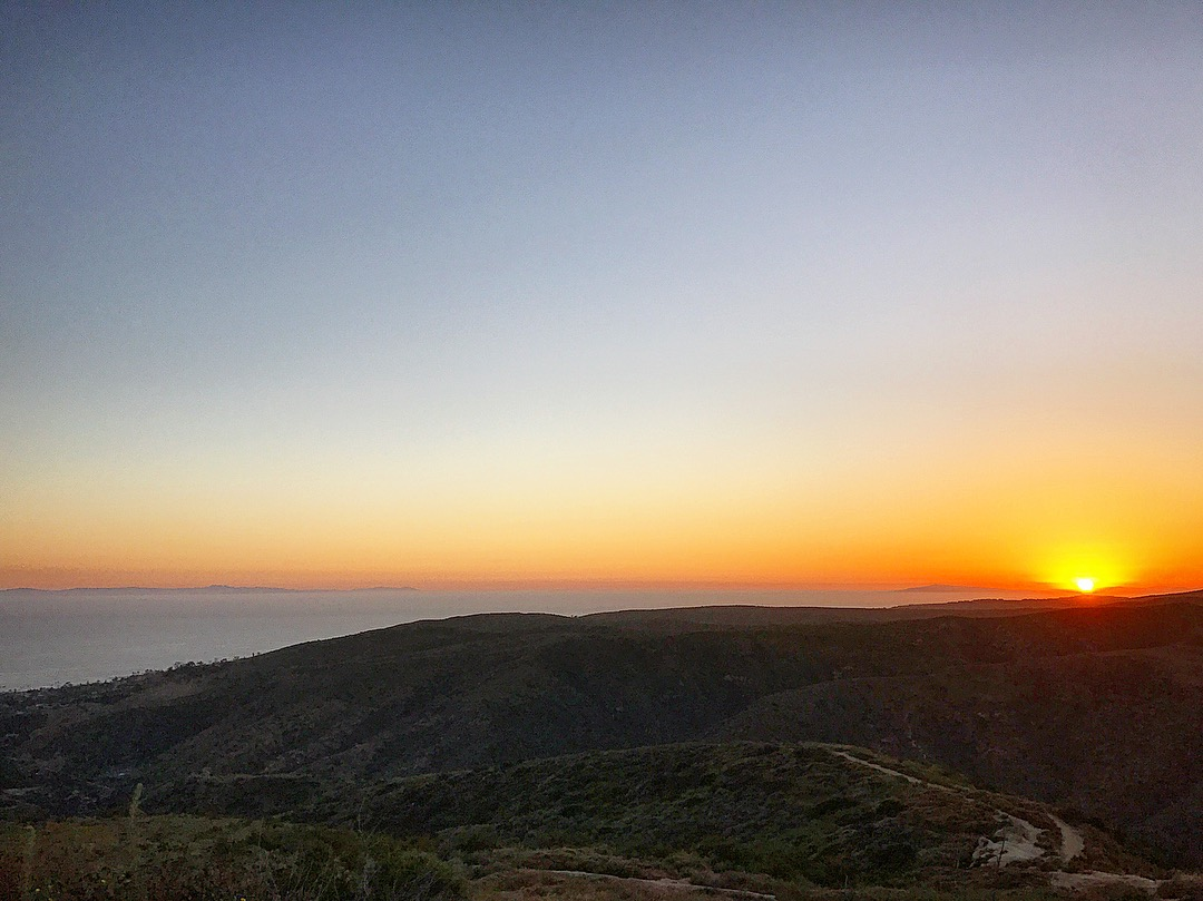 """Sunset at """"Top of the World"""" park in Laguna Beach. Upper left Santa Catalina Island can be seen."""
