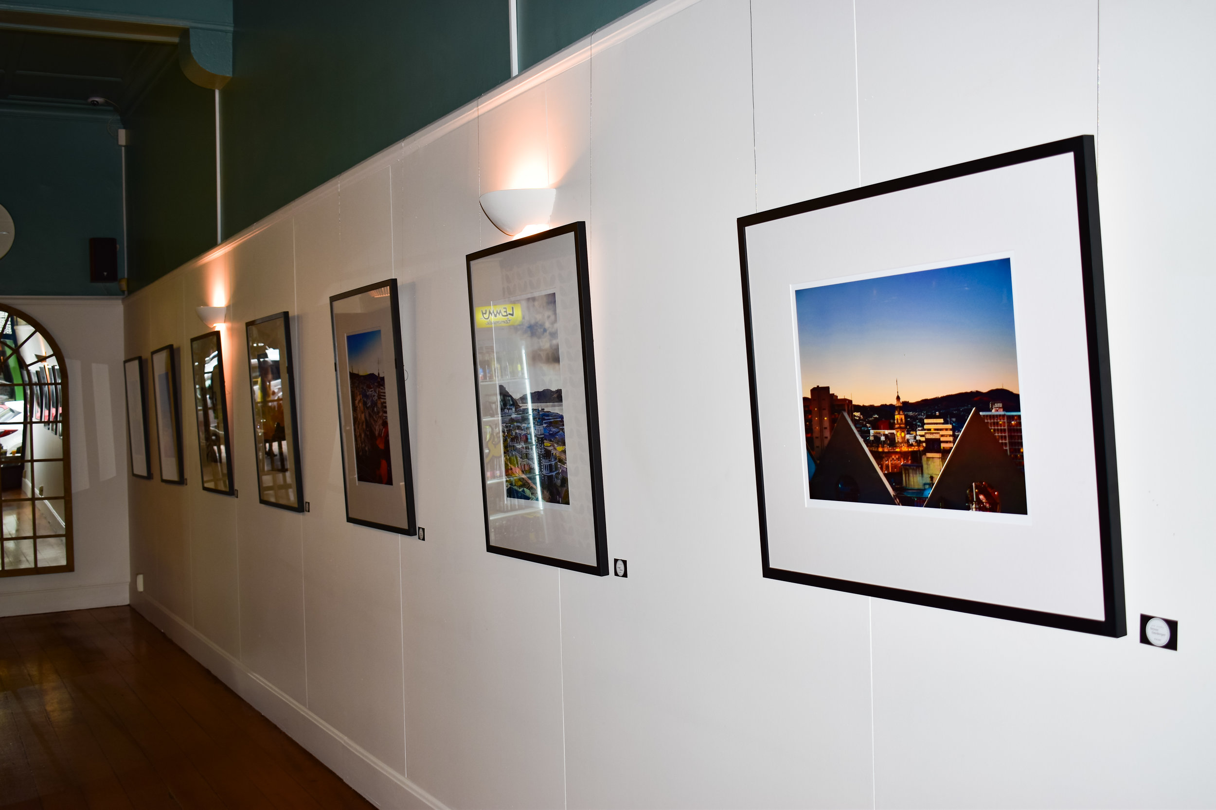 photography exhibition wall at cafe