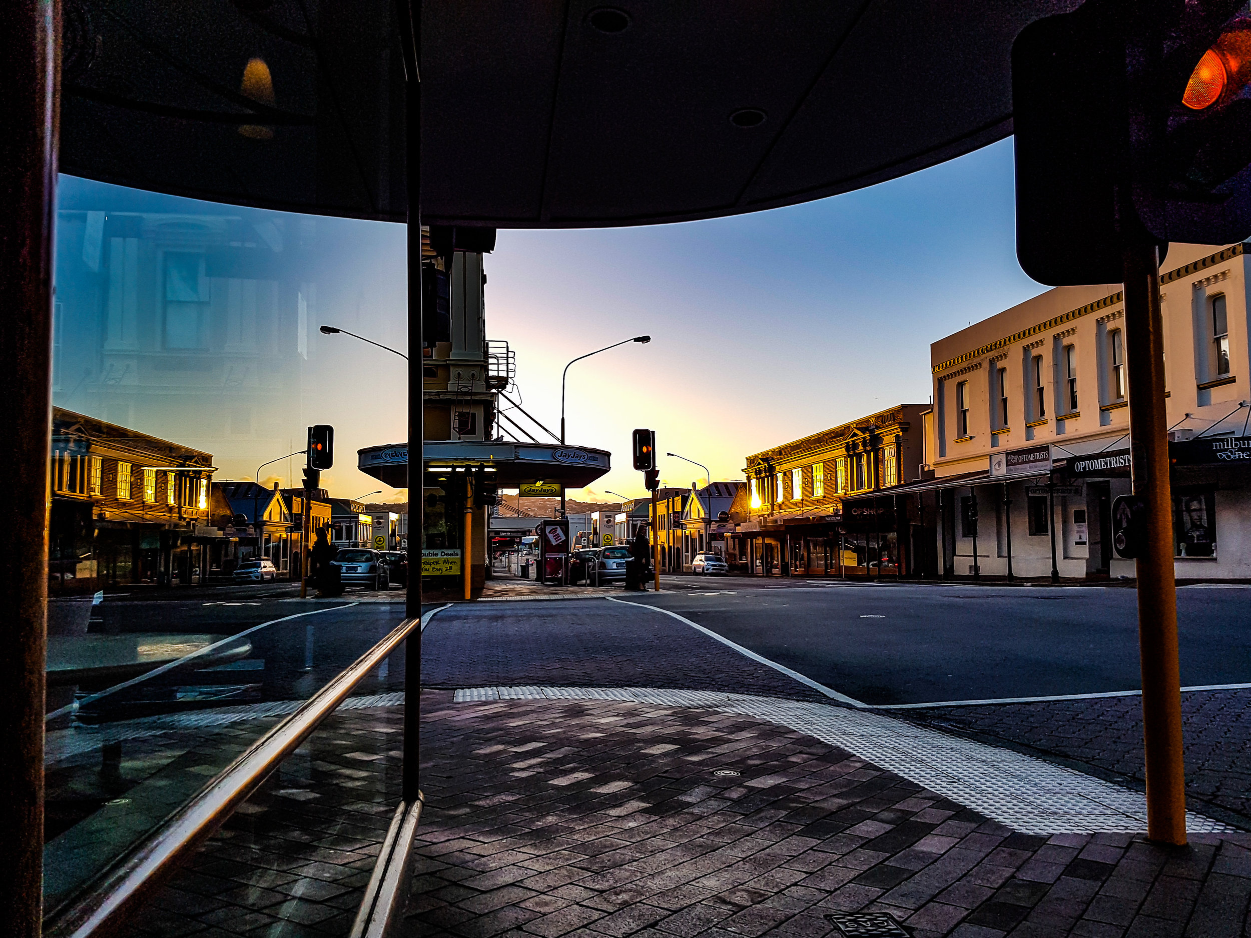 Reflection in a window of Dunedin shops