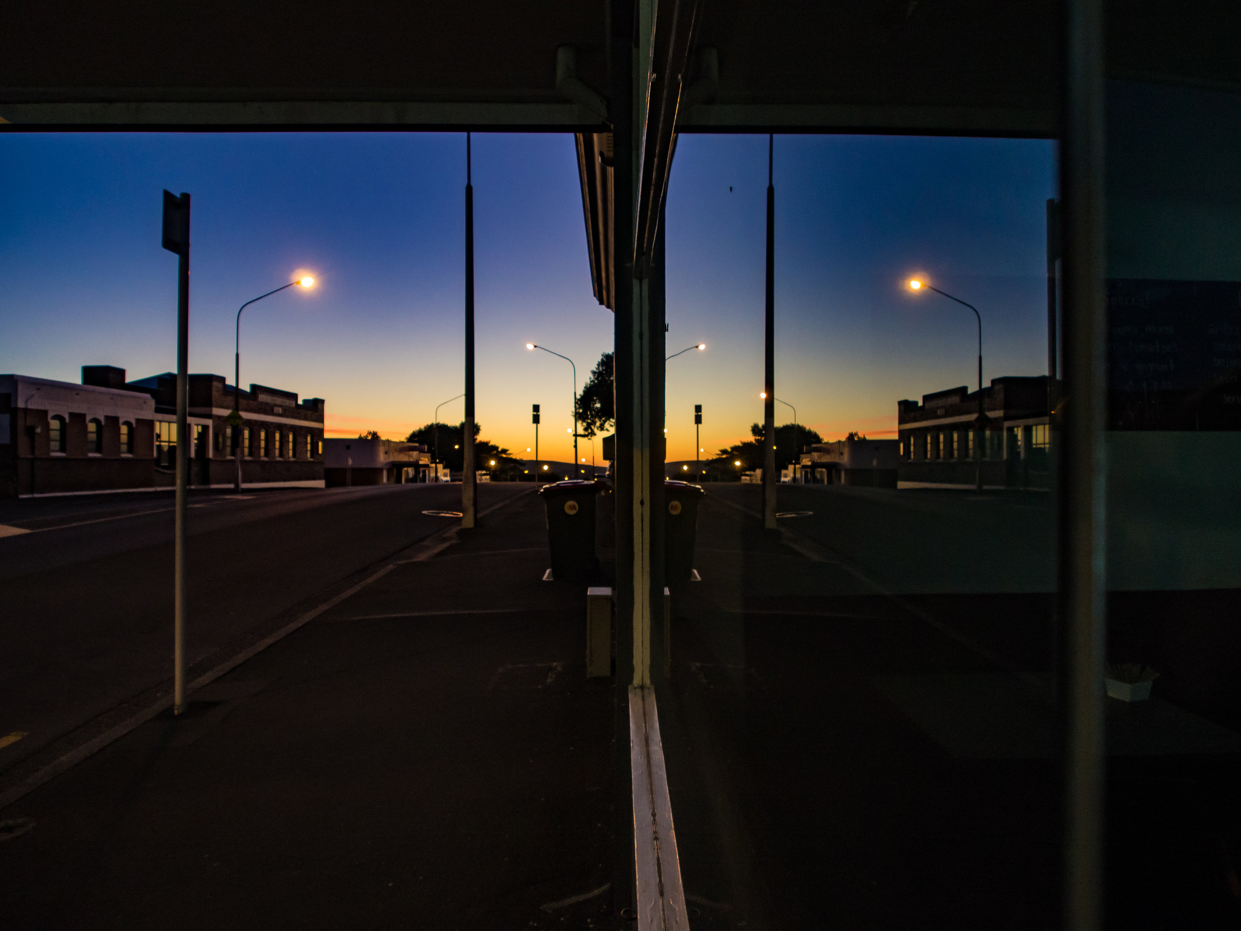 Sunrise window reflection at Alto cafe in Dunedin