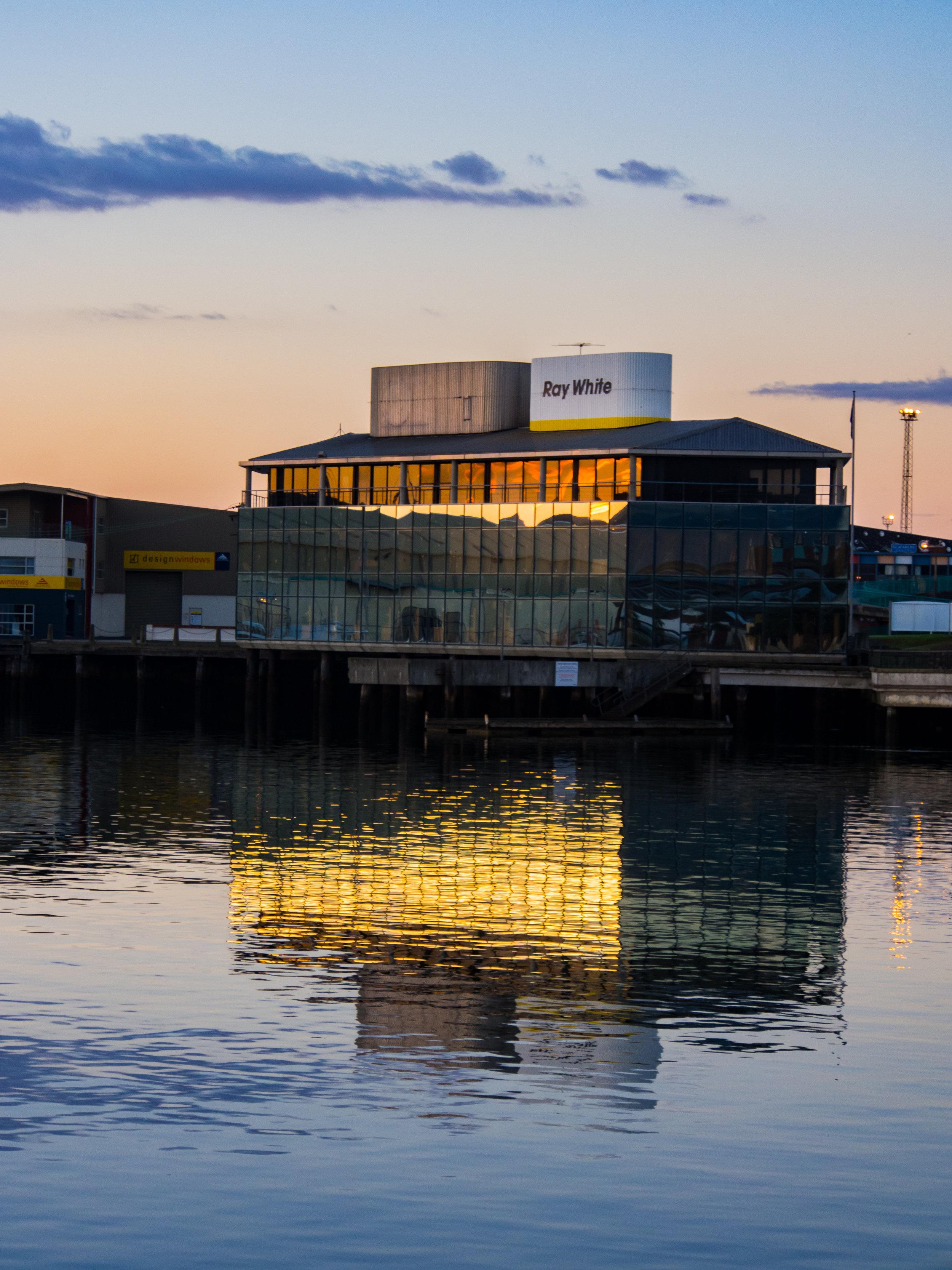Dunedin building reflecting in Otago Harbour