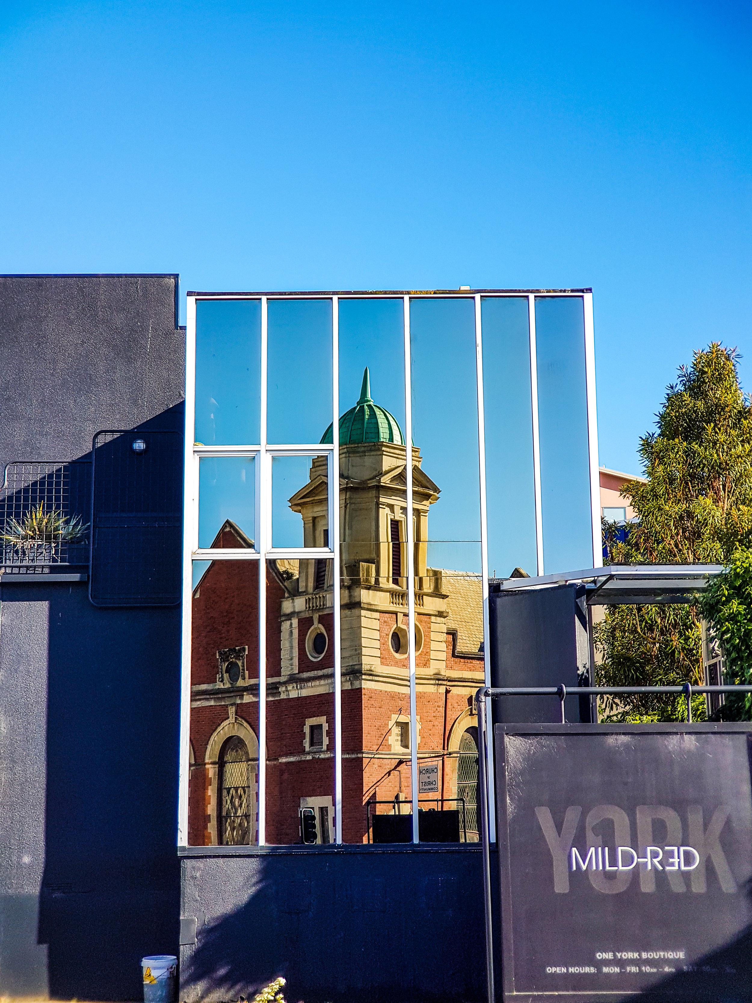 Dunedin church reflected in glass