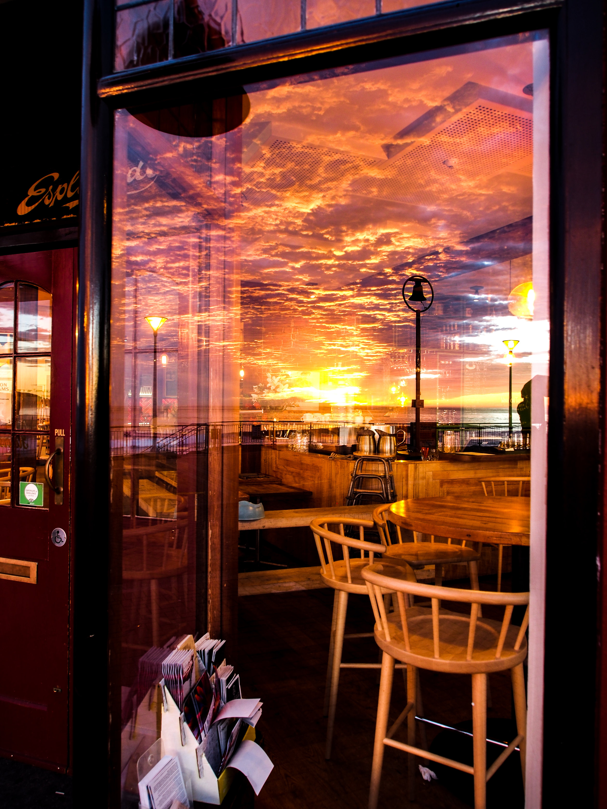 Sunrise at St Clair Dunedin reflected in The Esplanade window