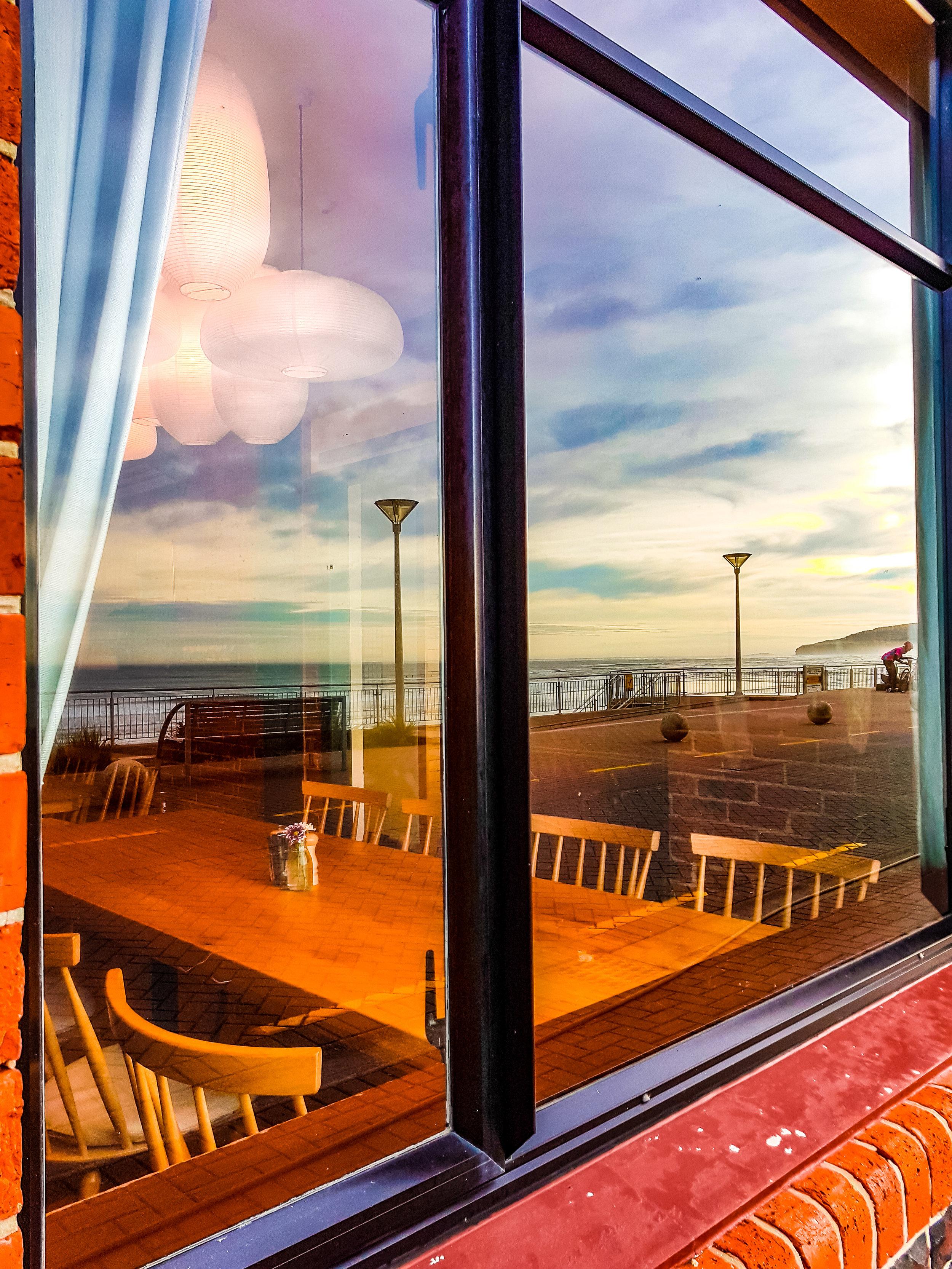 Table in a window at Esplanade restaurant Dunedin