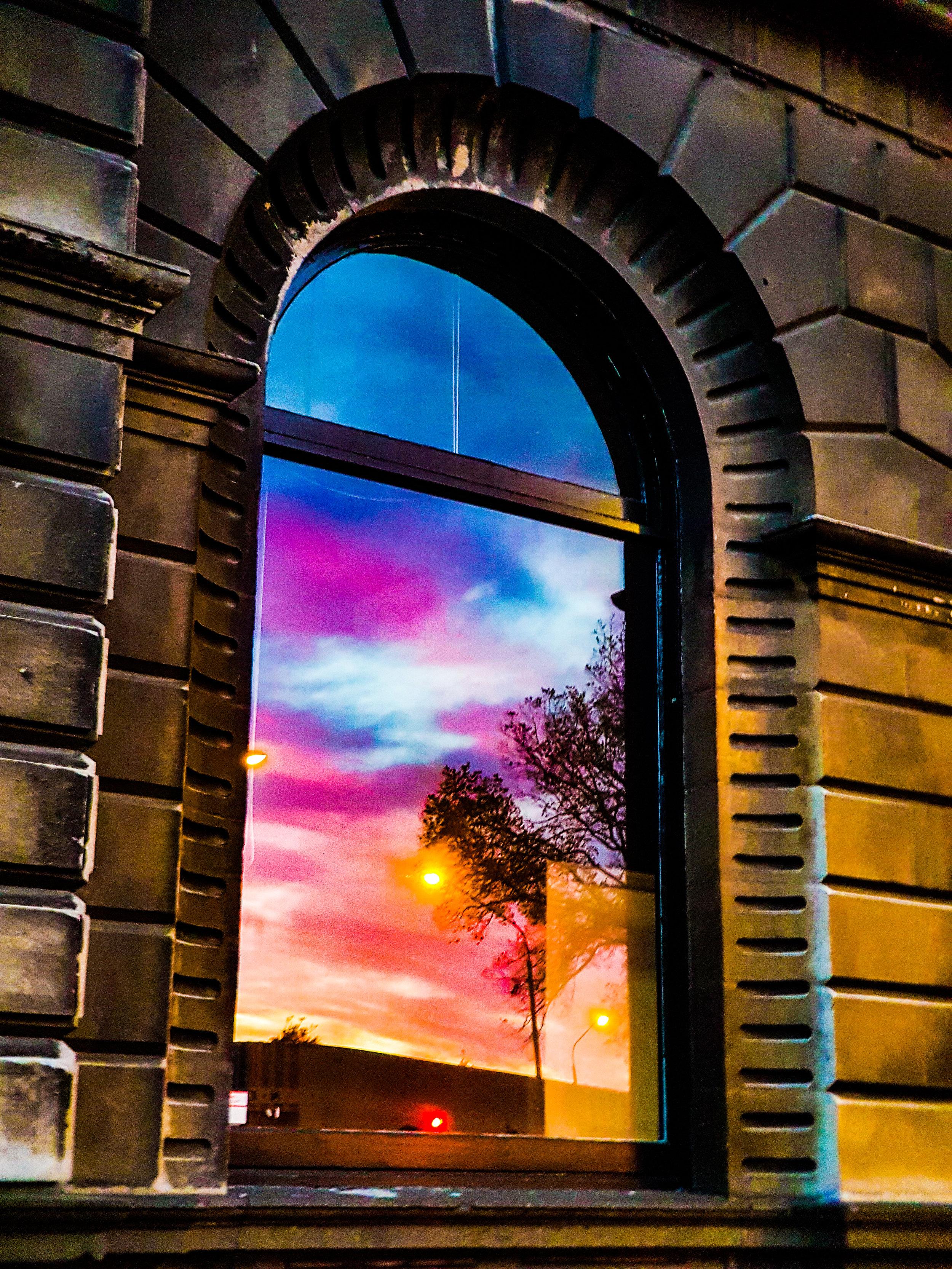 Heritage arched window sunrise in Dunedin
