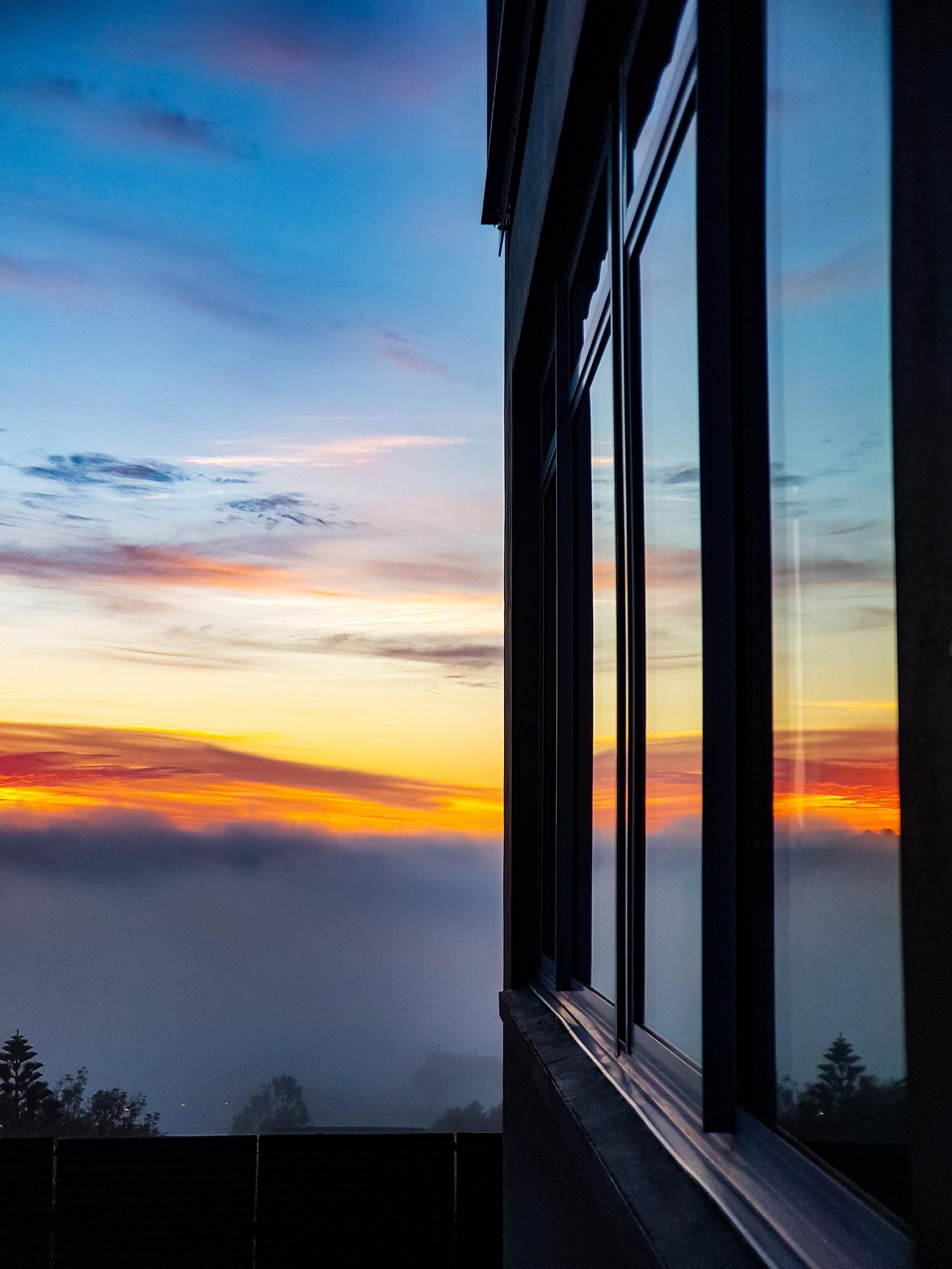 sunrise in a window at luna restaurant Dunedin