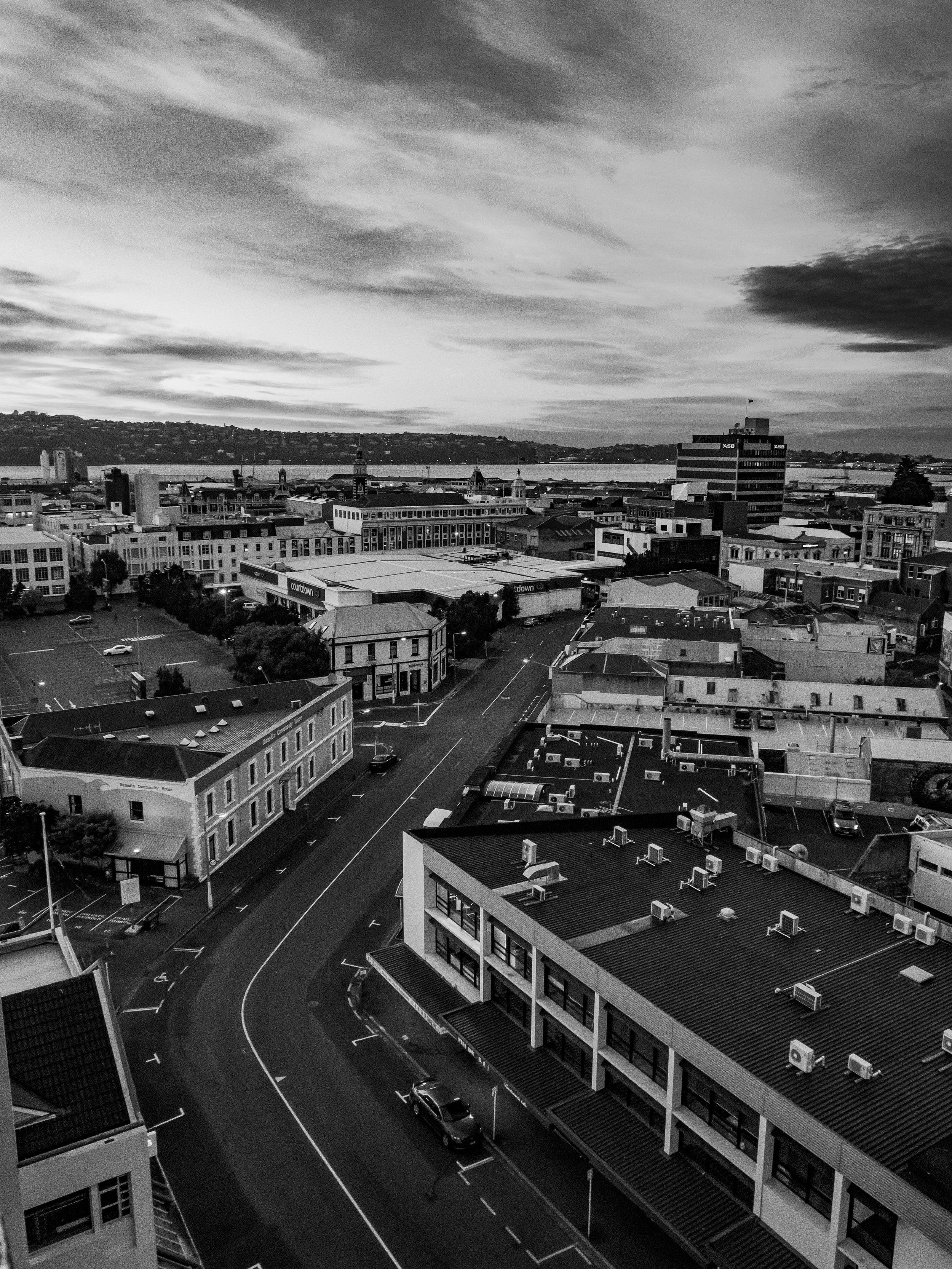 Sunrise over Dunedin City in black and white