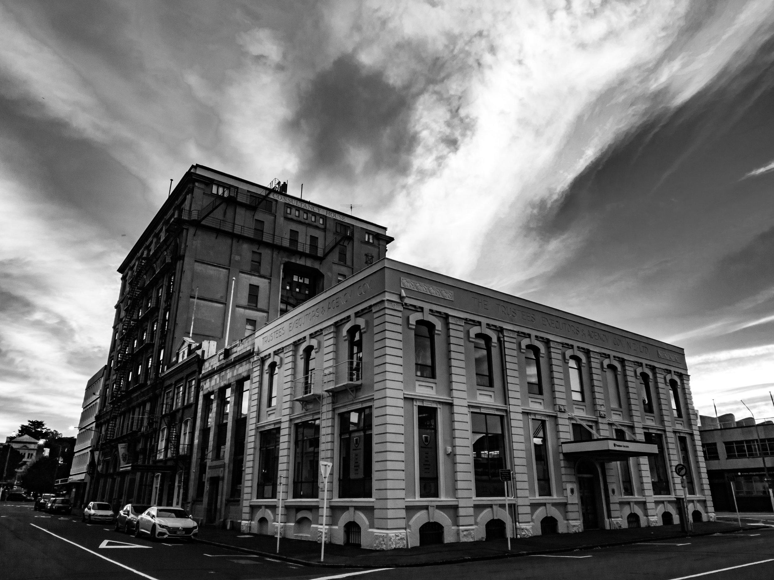 white streaking cloud over heritage buildings dunedin