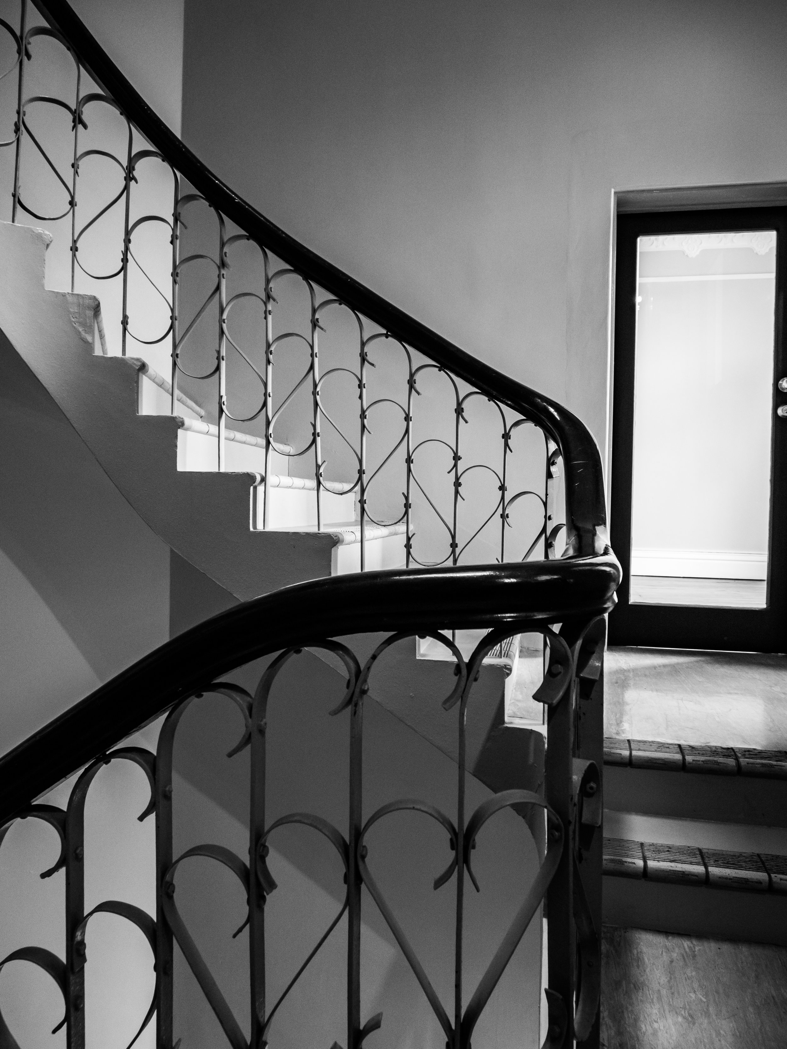 Curving staircase heritage in dunedin black and white
