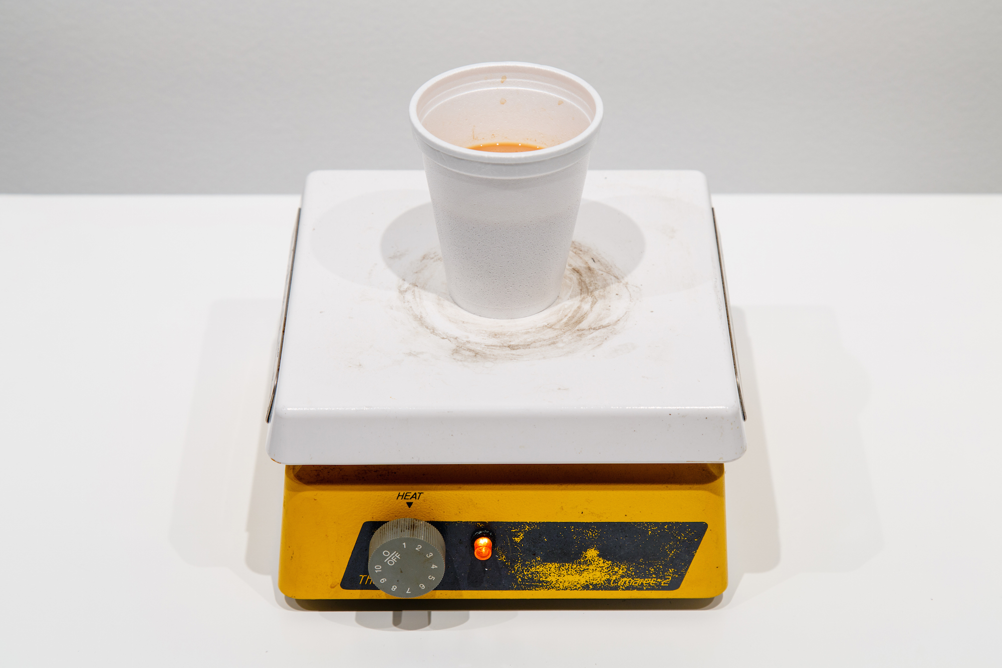 Half Cup Saffron 2015 Tea, sugar, condensed milk, glass cup, hot plate Dimensions variable