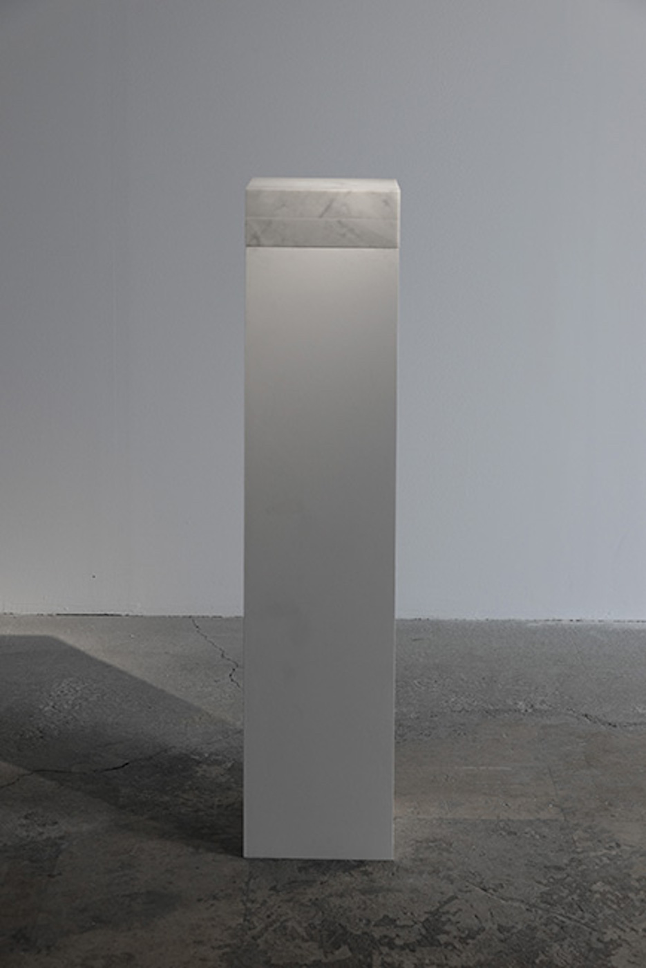 Night Enclosed in Marble 2012 – 2016 Carrara marble, 1cm3 of night of Kadisha valley Lebanon, hinges 23 x 23 x 9 cm   In 'Night Enclosed in Marble', the artist transported a Carrara marble box to a forest in Mount Lebanon on a dark night without moon (Dark Moon). He then opened the block for just a few seconds to capture, in the void sculpted inside of the box, 1cm3 of this specific night. The captured night will rest in the darkness of the crate for eternity. (The marble block opens like a book. In each of its massive interior part, 0.5 cm3 of void was carved, when closed it contains 1 cm3 of void at its center of gravity.)