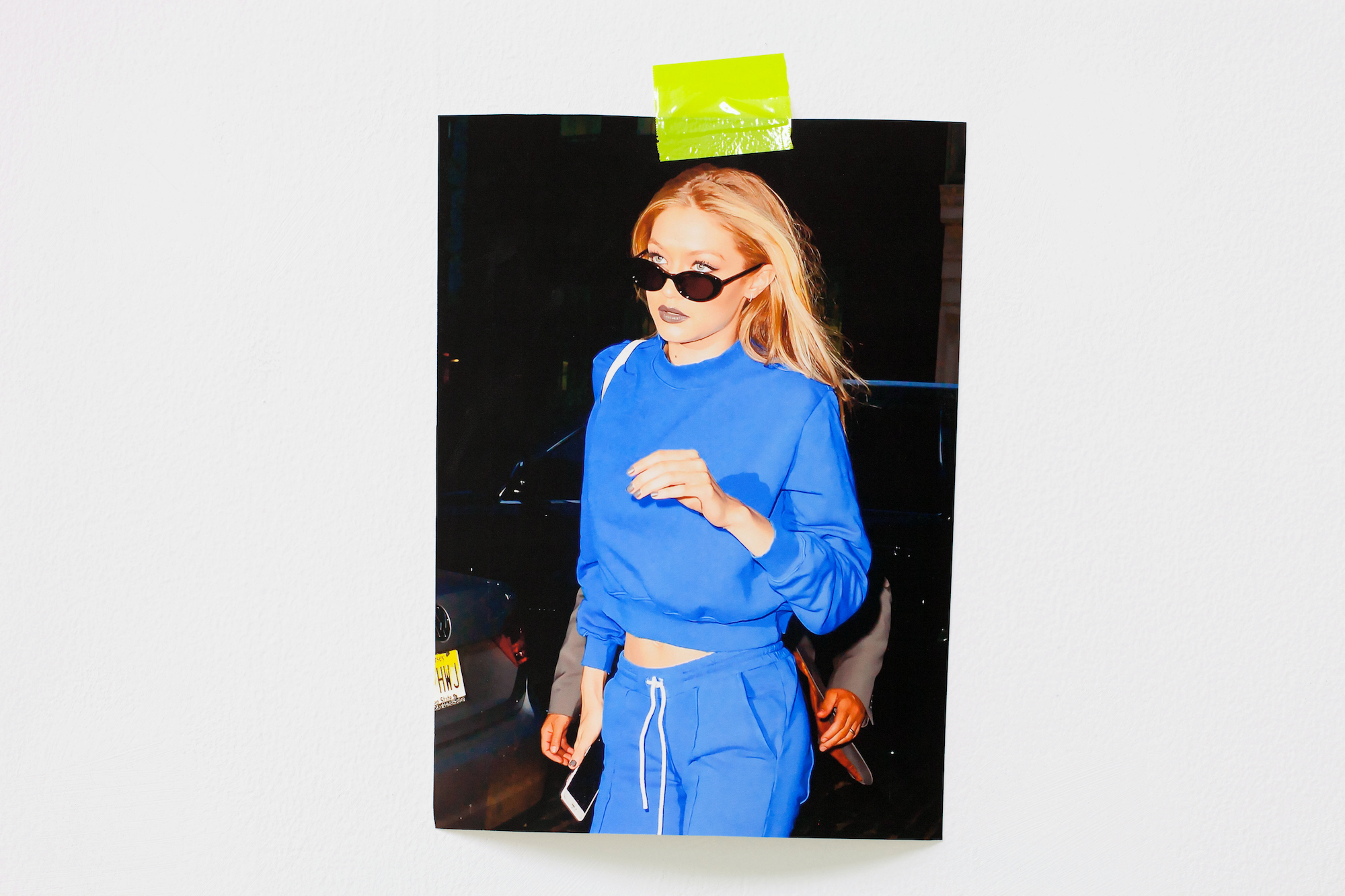 Raja'a Khalid  GIGI EYES   2017 Archival inkjet print, tape 25 x 35 cm *Photograph of supermodel Gigi taped to the wall.
