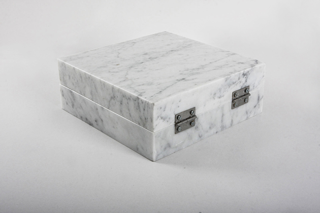 Night enclosed in marble (back) 2013 (ongoing series) Carrara marble, 1 cm3 of a night (Naas Forest, Mount Lebanon), metallic hinges 23 x 23 x 9 cm