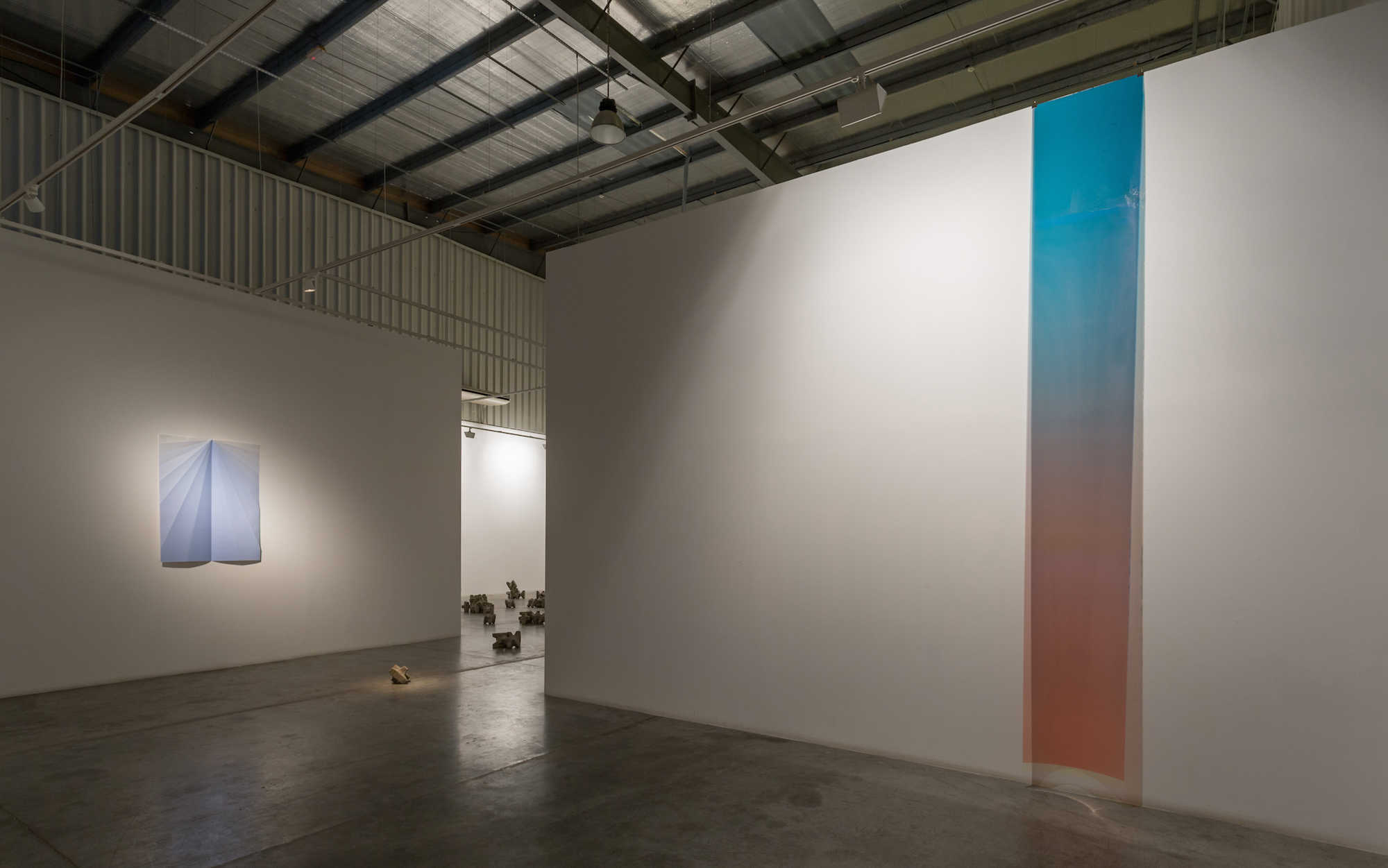 LEFT - RIGHT  LEFT:  Blue Paperplane, 2015, inkjet on folded paper, 146 x 105 cm  CENTER: Rhythm Breakers, 2015, concrete, dimensions variable  RIGHT: Processing Days and Nights 1, 2015, Unique inkjet print on Negative Permajet transfer film, dimensions variable