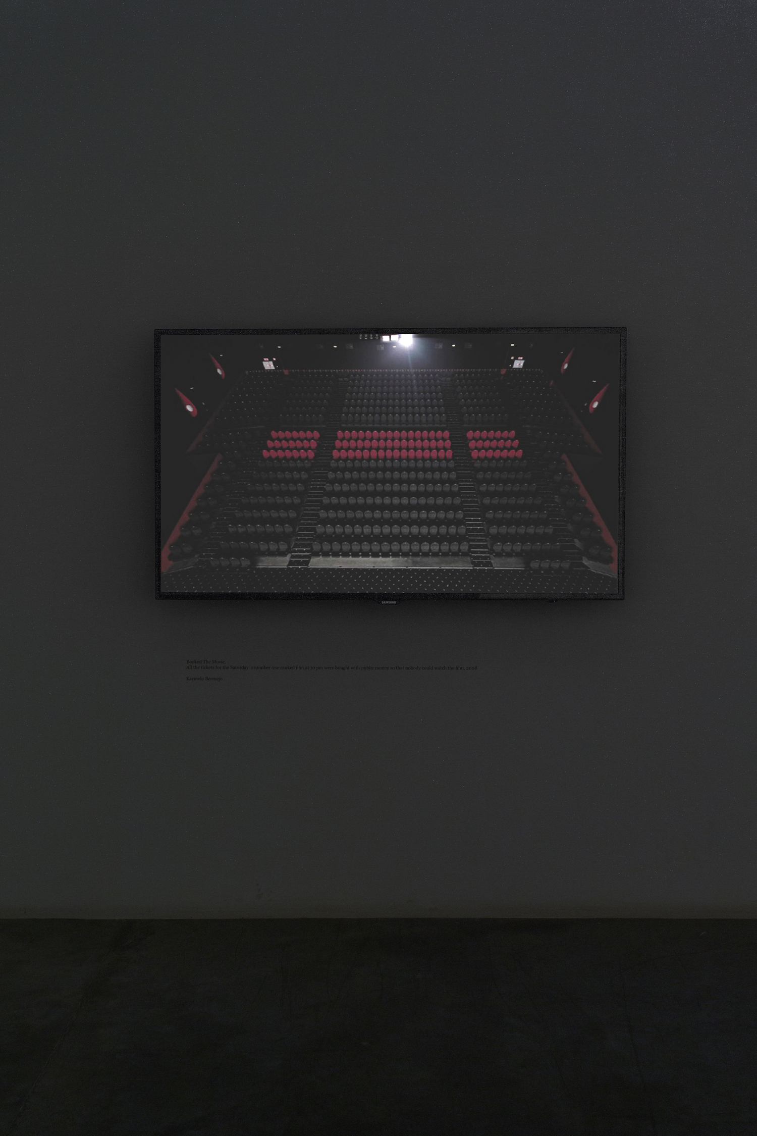 Installation view  Karmelo Bermejo Booked The Movie. 2008 HD video, silent 00:94:00 loop Edition of 4 + 1 AP