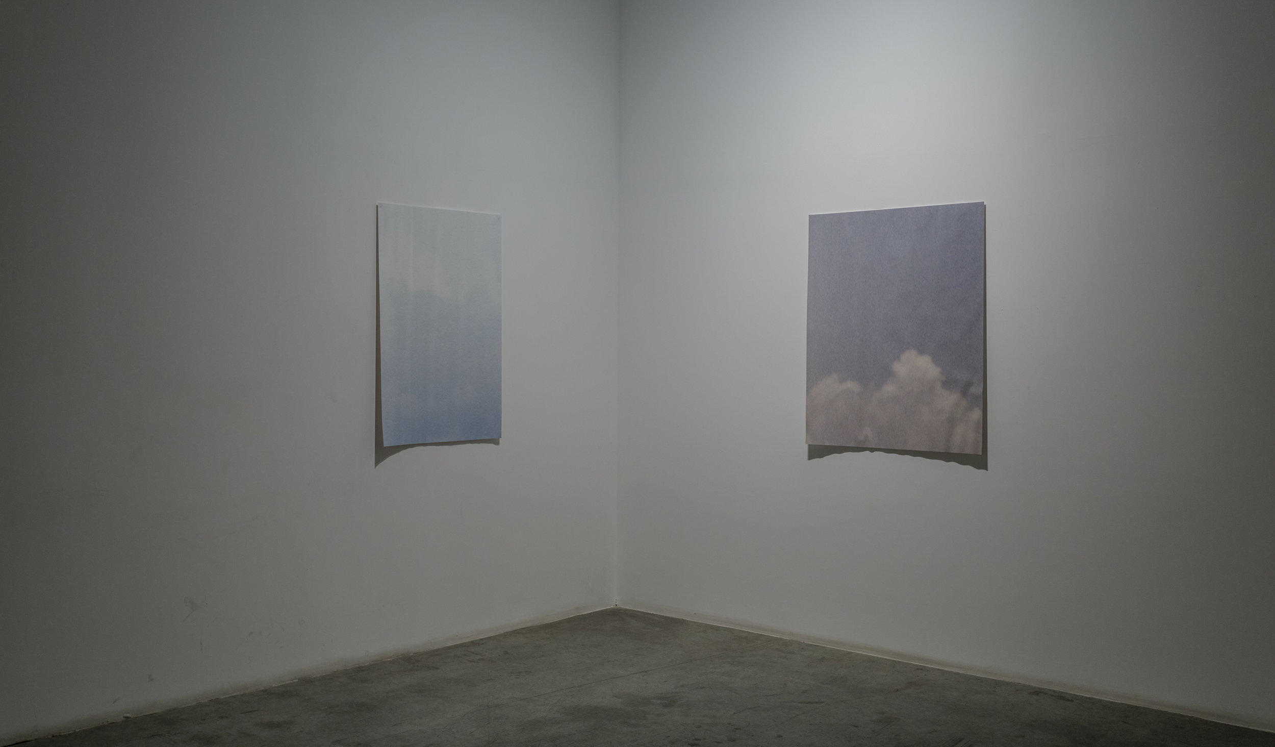 Stéphanie Saadé  The Sky is a Village 2016 Printed photographs left outside 115 x 78 cm and 115 x 95 cm Pieces of sky from childhood photographs are scanned and enlarged to the size of the artist's studio's windows. The marks left by the rain, wind and air reactivate them today.