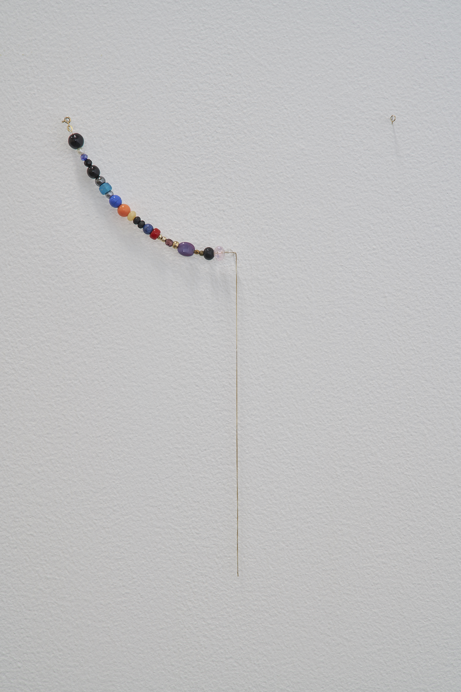 A Necklace of Found Beads 2014 - 2019 18-carat gold chain, 25 found beads Dimensions variable   A necklace is composed of beads found by chance by the artist between 2014 and 2019. Left open, it will complete once the number of beads matches the age of the artist.