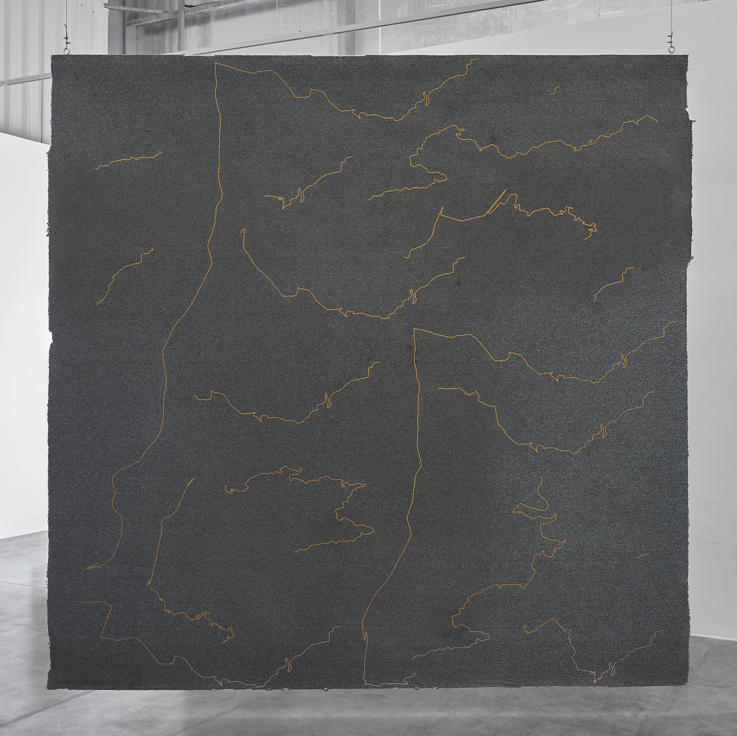 Stéphanie Saadé  The Encounter of the First and Last Particles of Dust 2019 Old carpet, embroidery 333.5 x 336.5 cm The carpet of the room which the artist occupied as a teenager, from 1995 to 2001, is torn off and embroidered with the 18 most significant trajectories underwent during this time span.
