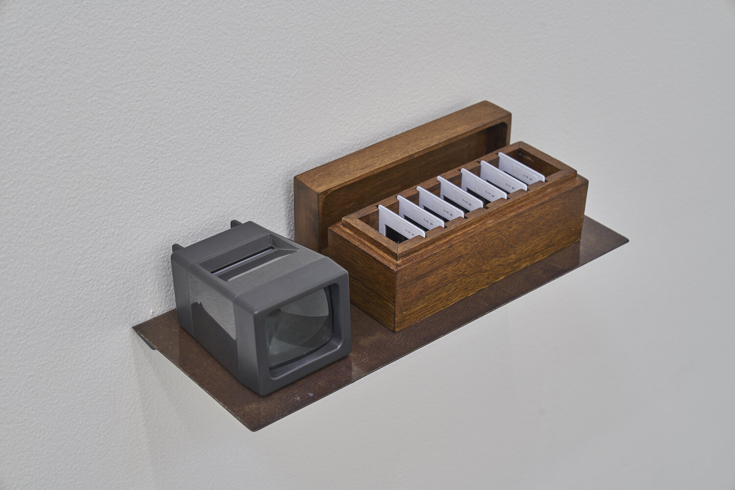 The Clay Files 2019 Seven 35 mm slides, slide viewer, wooden box, metal shelf Dimensions variable Edition 1/2