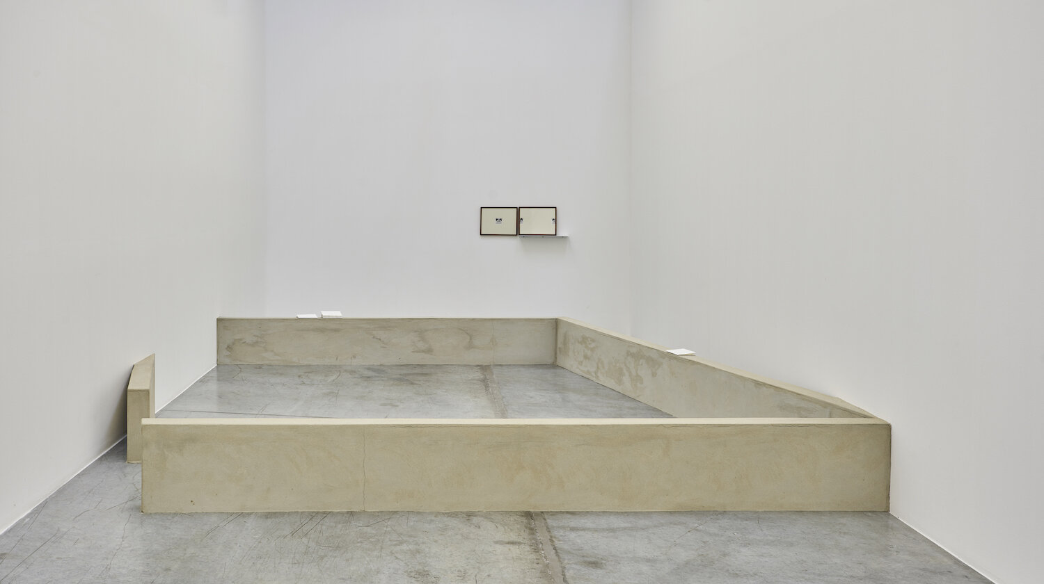 THIS IS A MIRAGE, AN IMAGE, A MONUMENT AND/OR A SHRINE, 2019, cement, sand, concrete board, publication (PUBLICATION + WALL)