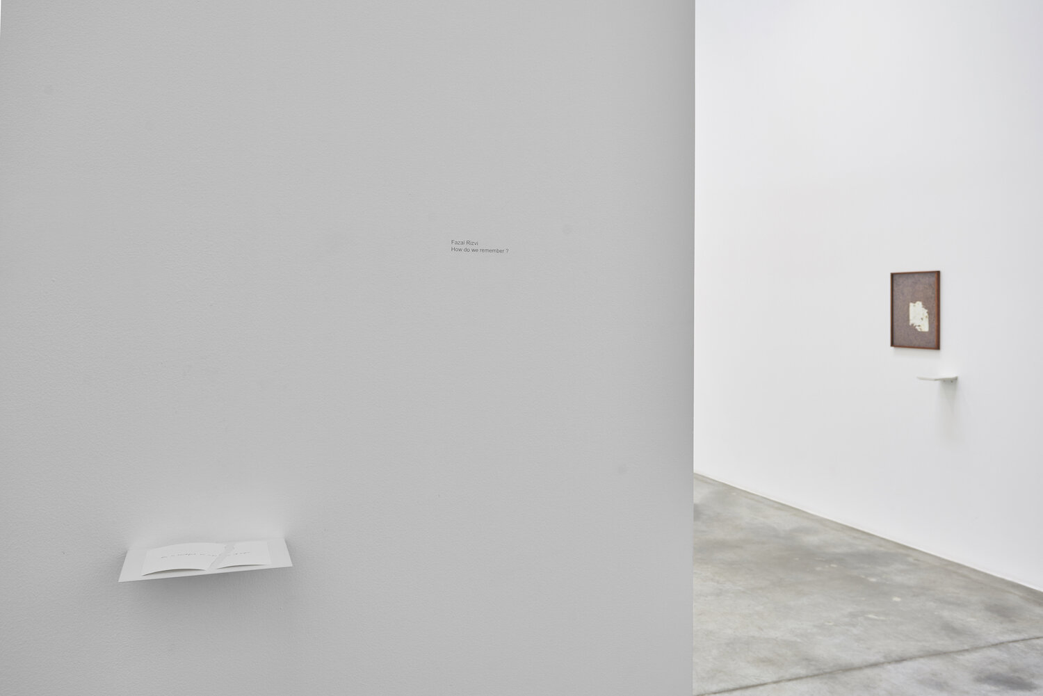 L-R  She is beautiful on a piece of paper, 2019, handwritten text on paper, metal shelf, dimensions variable  /  The Visit, 2019, archival print on canson infinity paper, offsetprint, metal shelf, 45.72 x 35.5 cm (frame) / 16.5 x 11.7 cm (metal shelf), Edition 1/4