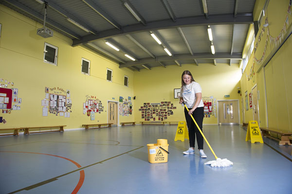 Mopping school sports hall floor