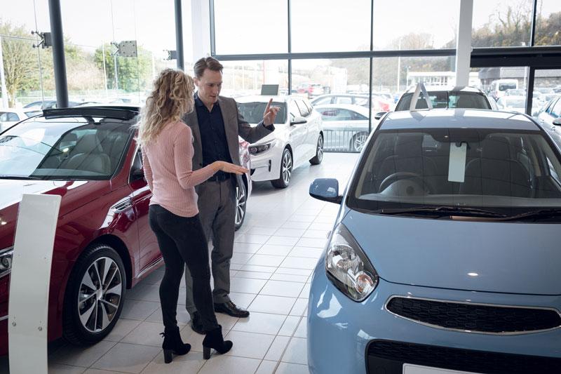 Car salesman with customer