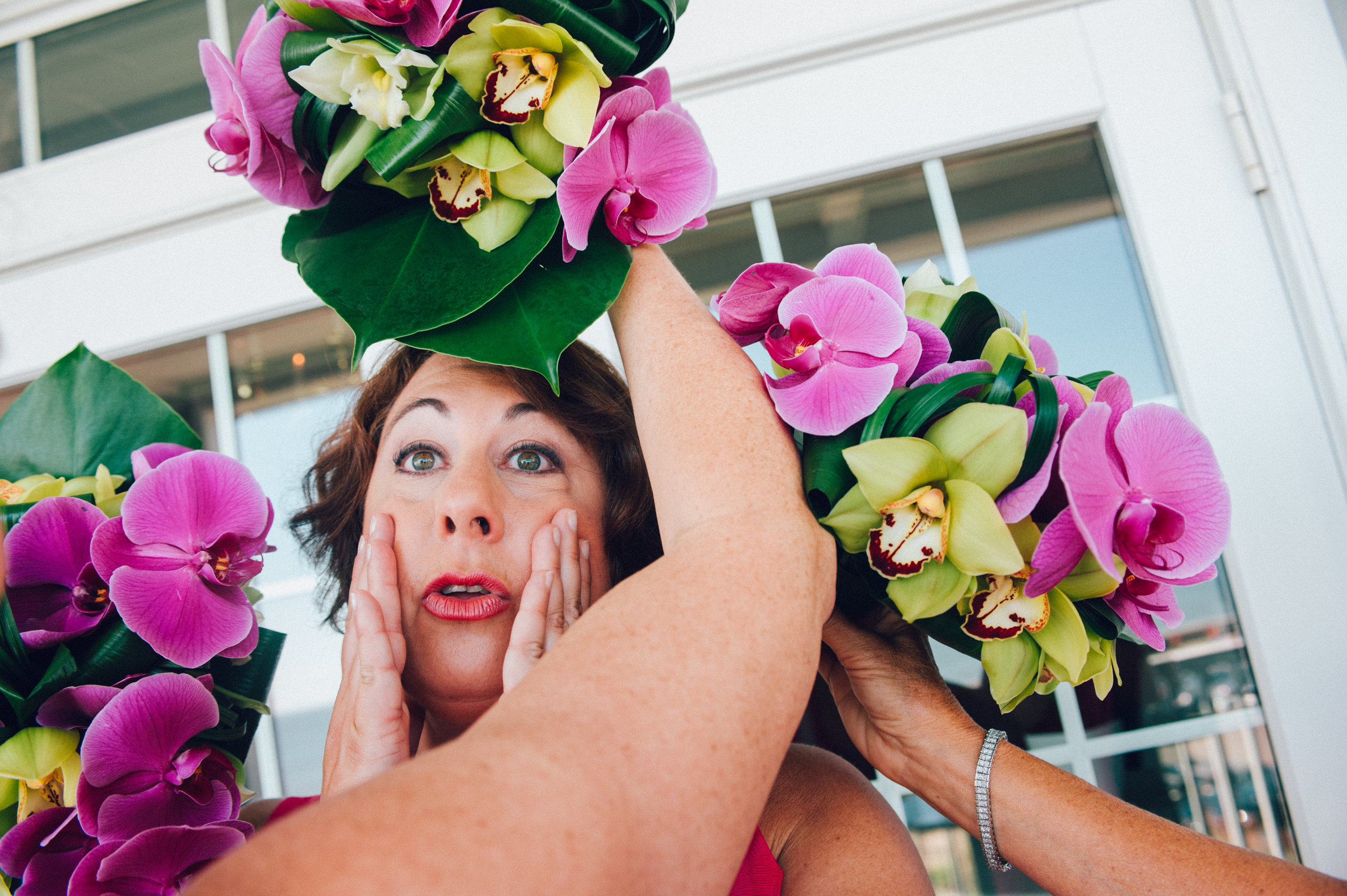 Woman at wedding surrounded by purple orchids