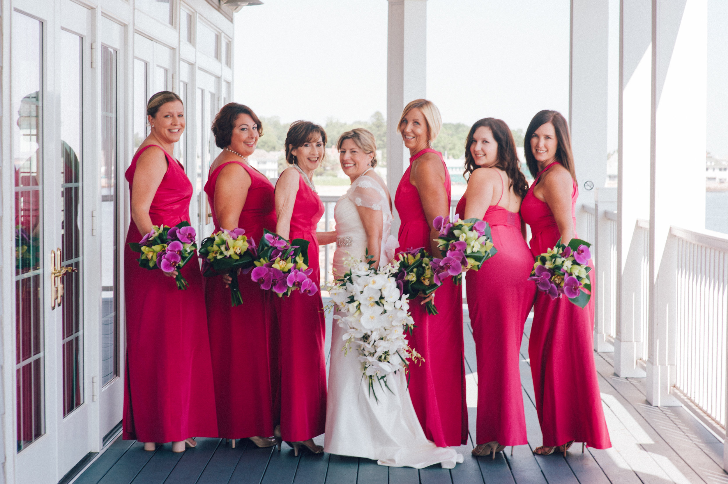 Destination wedding with bridesmaids in pink dresses