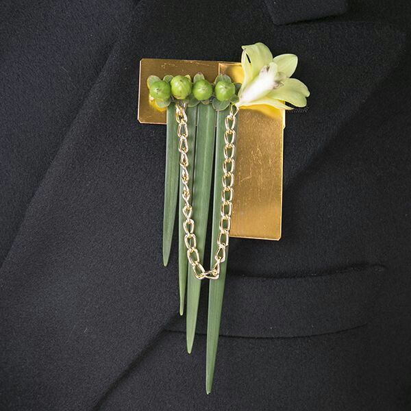 Unique gold corsage with greenery for a wedding from Bouquets and Beyond